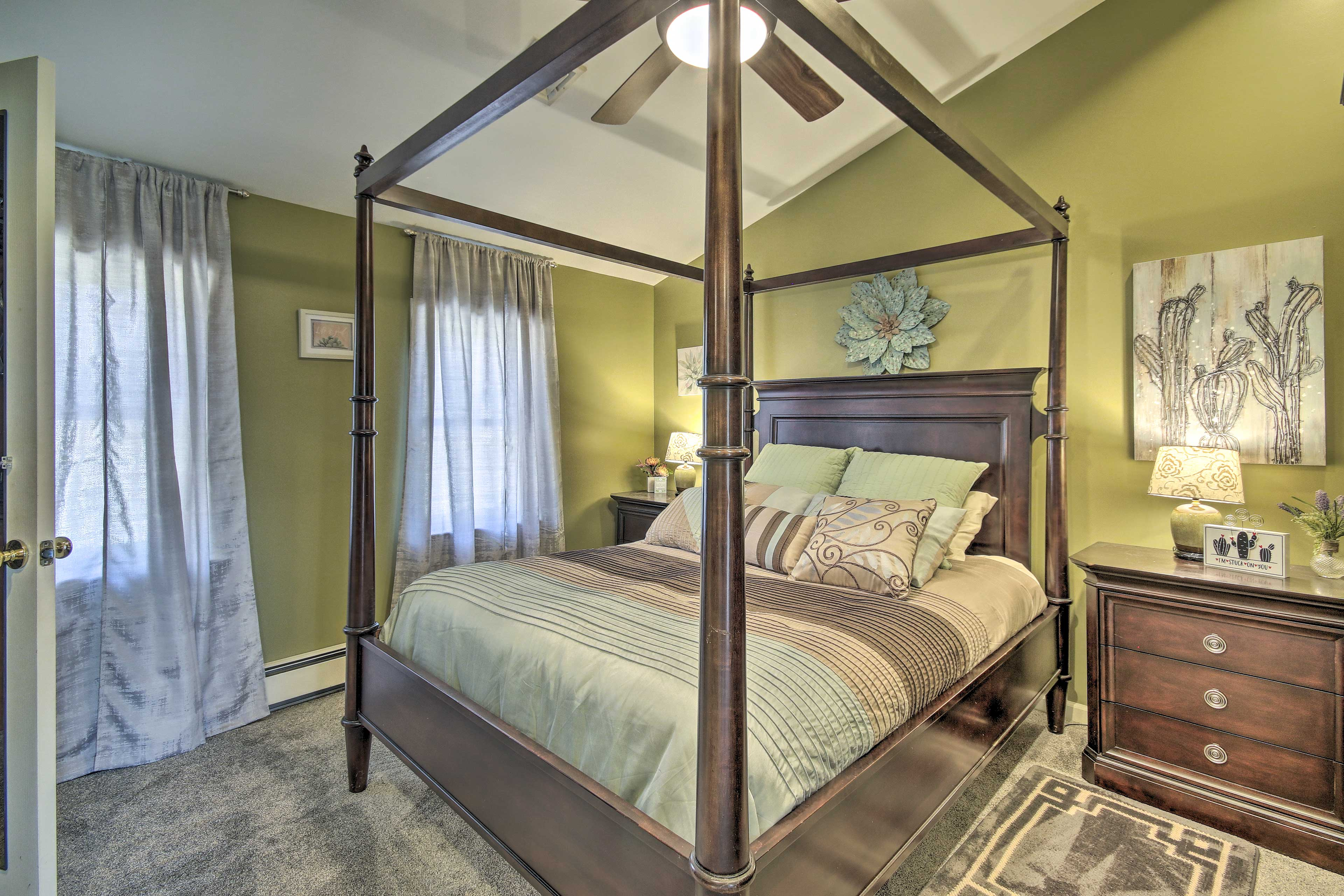This bedroom hosts a 4 post, full-sized bed.