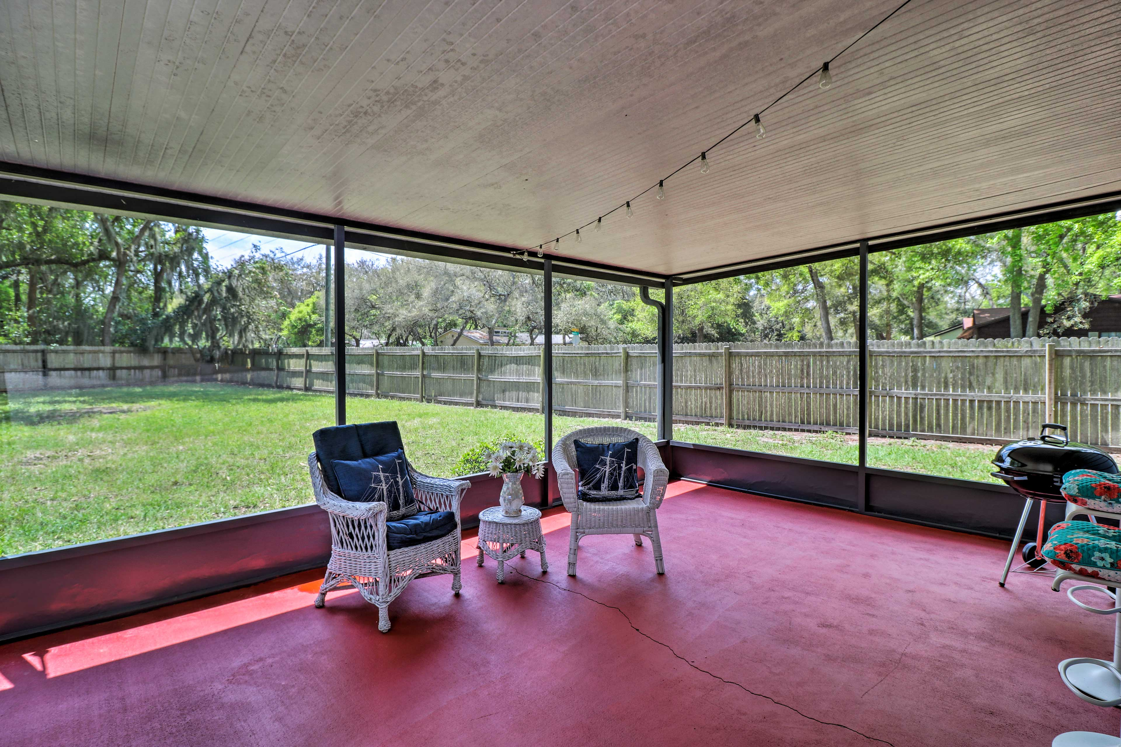 The property boasts a screened-in porch and large yard.