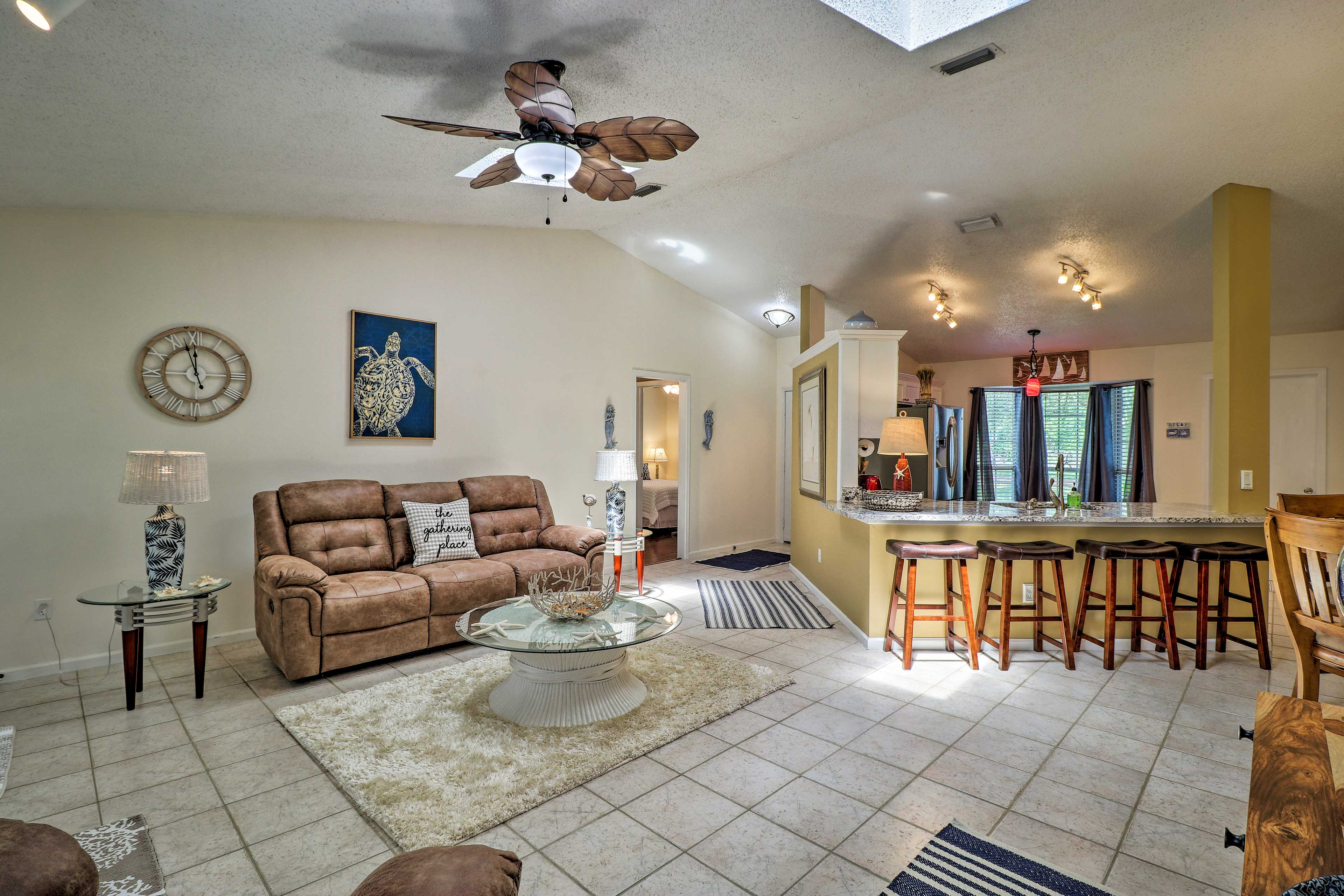 With cathedral ceilings, the living room is spacious and bright.