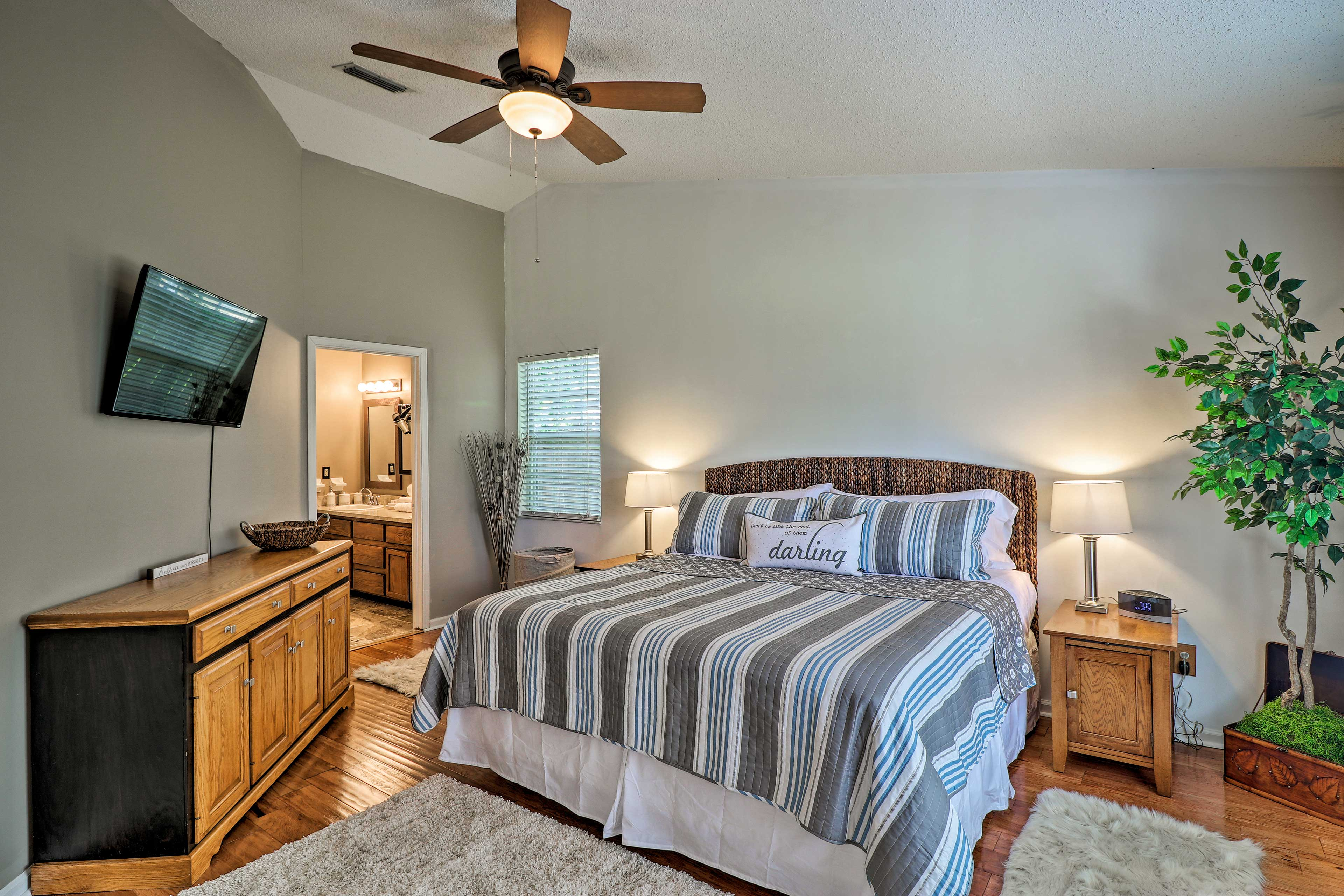 The master bedroom offers a king bed and flat-screen Smart TV.