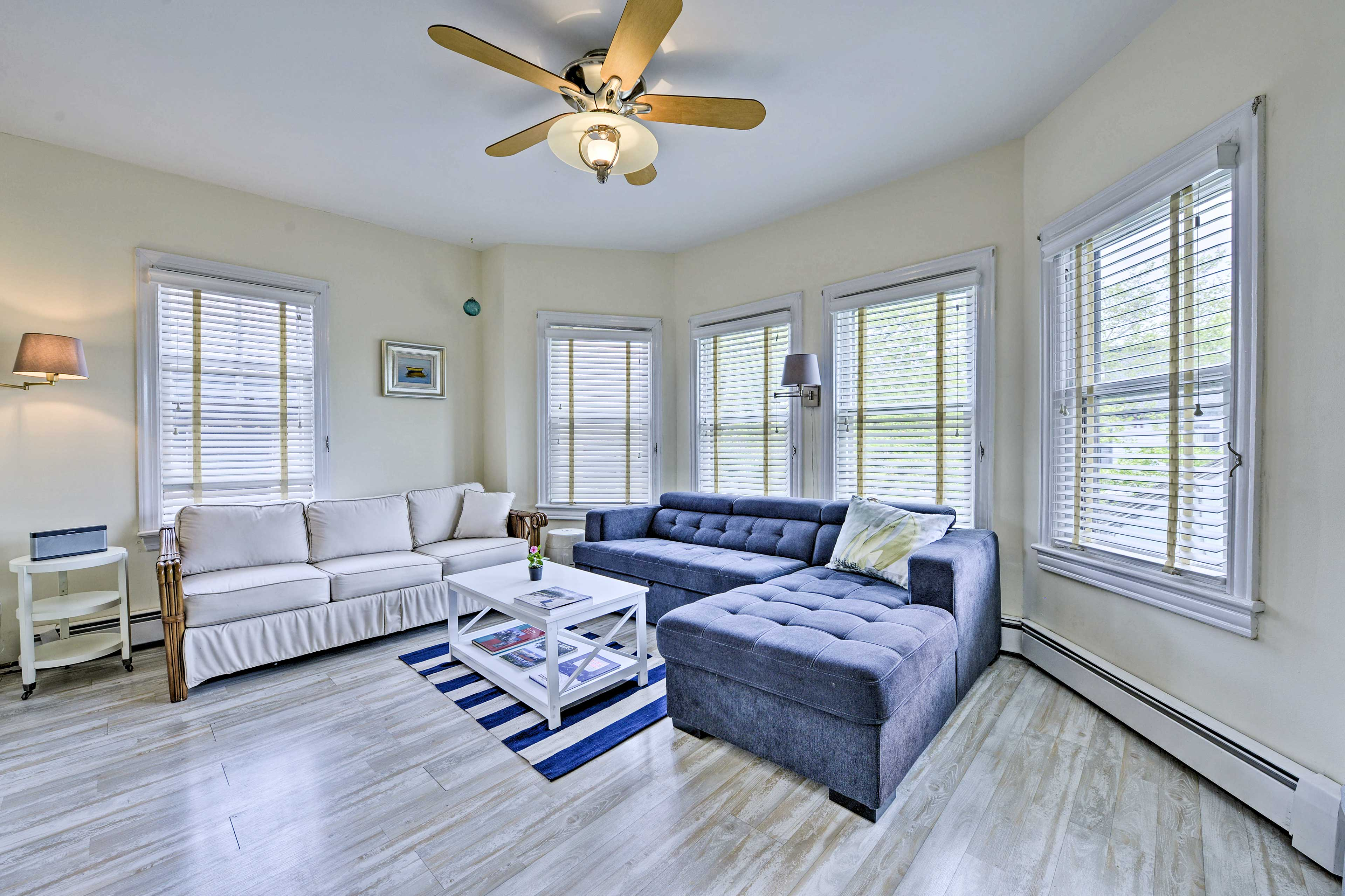 The living room is filled with natural sunlight each day.