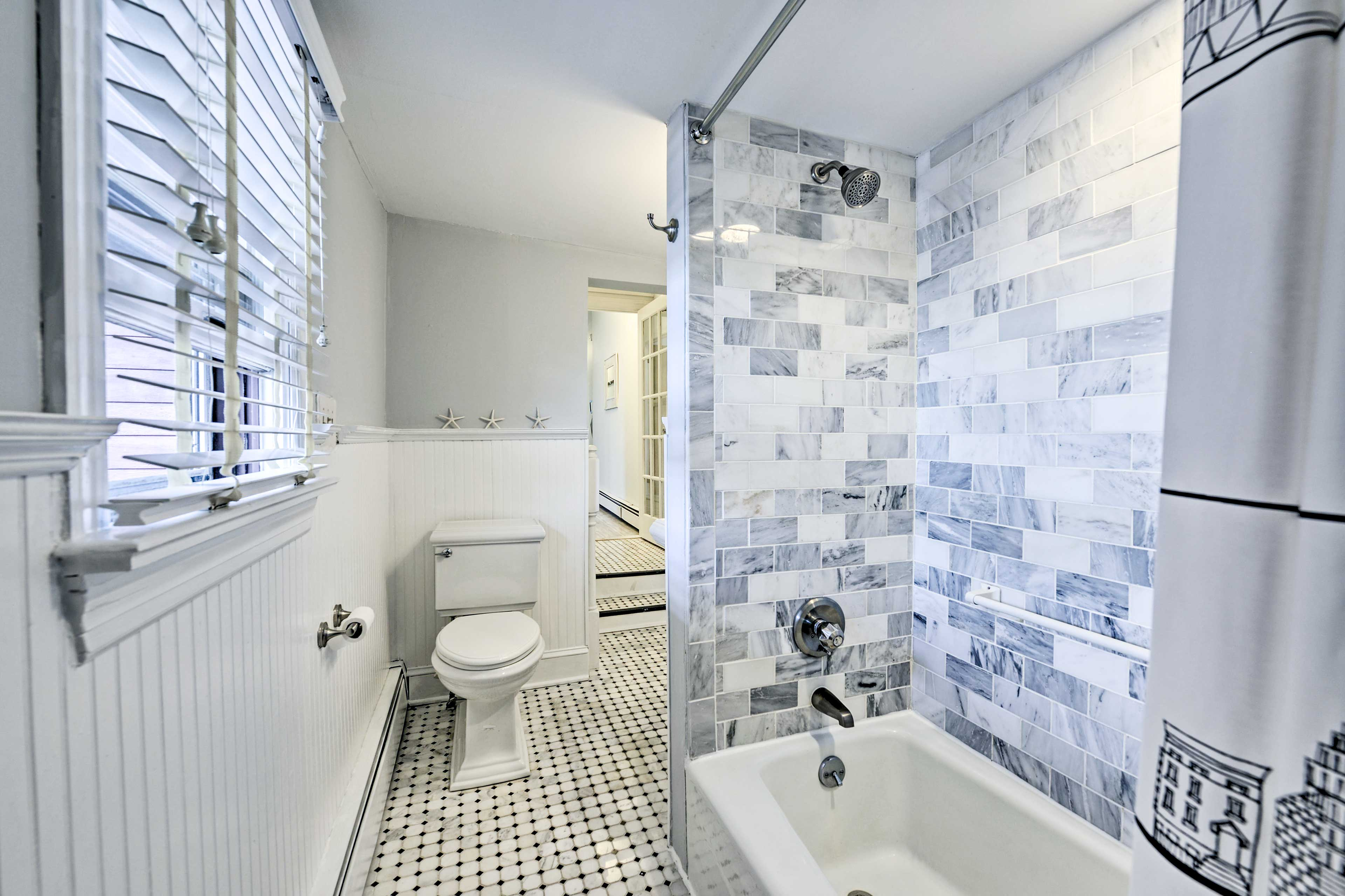 You'll love the tile-filled shower/tub combo.