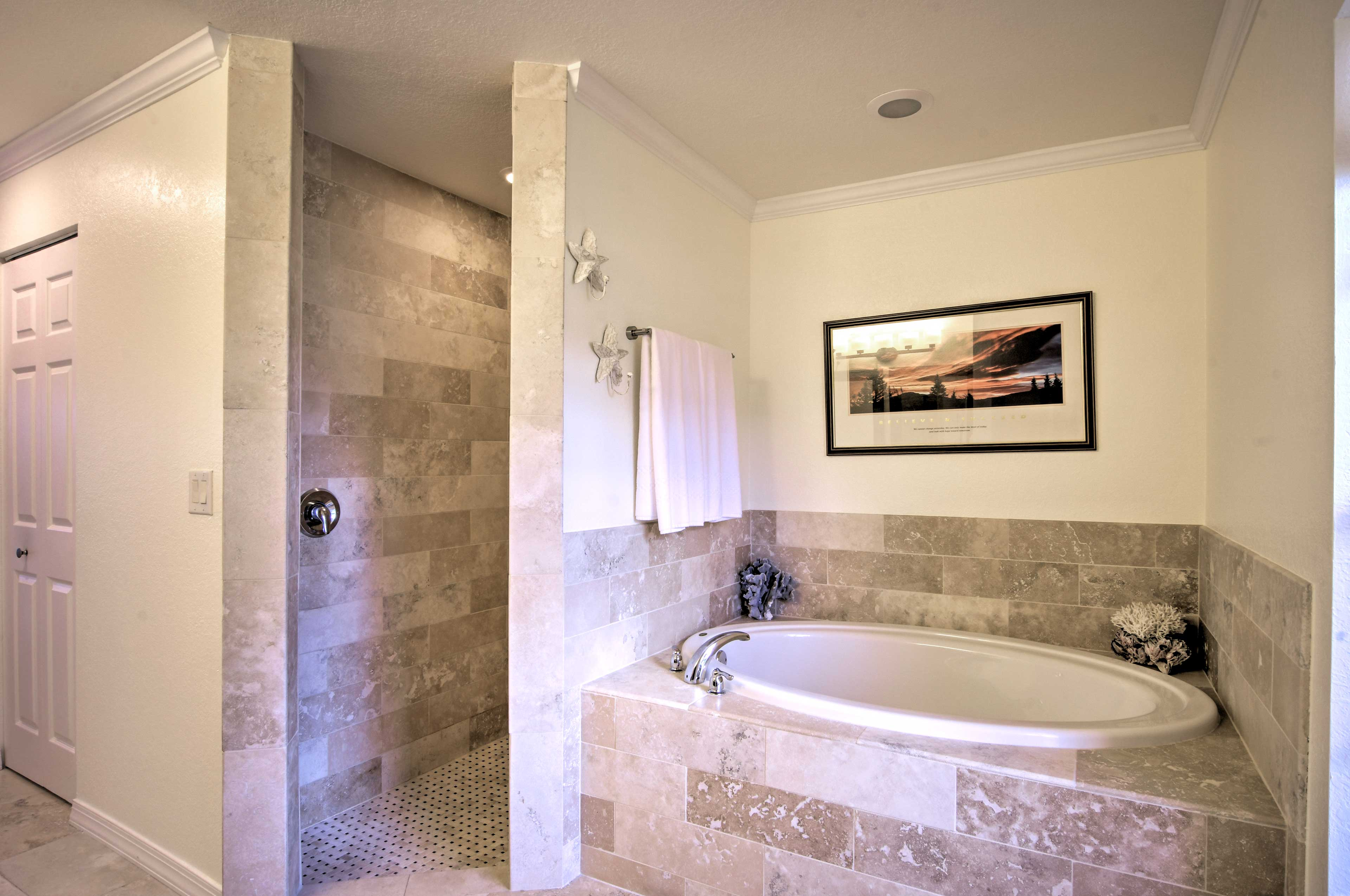 Sink into the tub or step into the shower.
