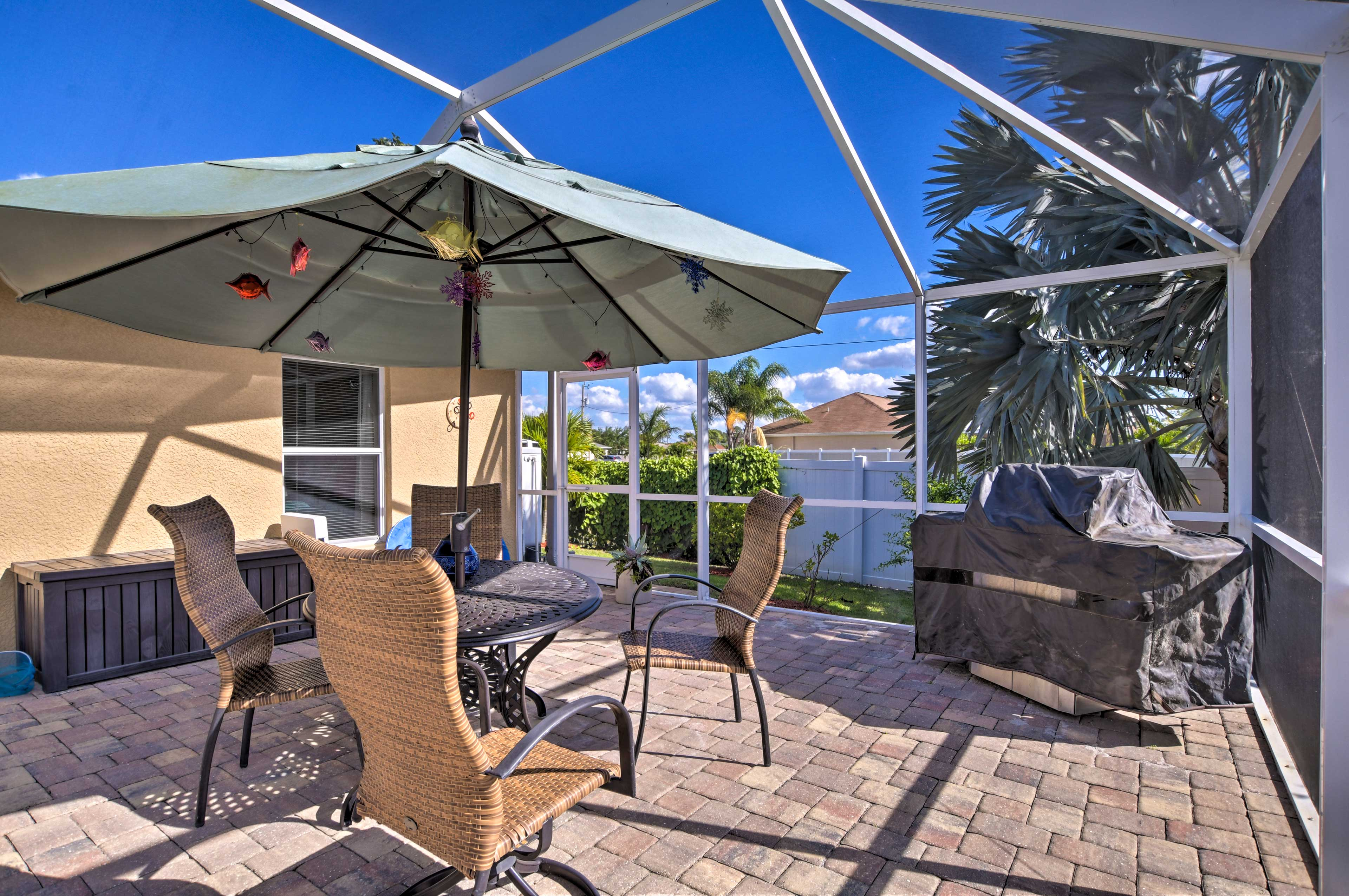 Enjoy barbecues while palms trees sway right outside this covered patio.