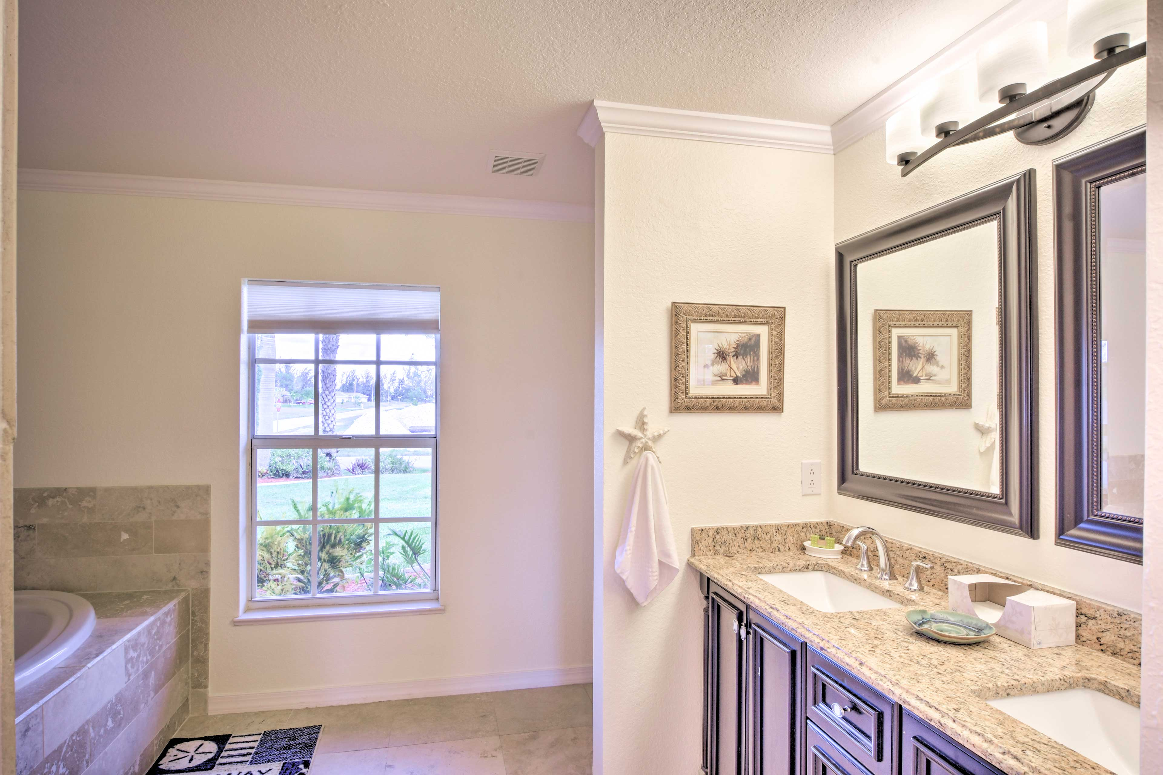 Jack-and-Jill sinks highlight this expansive bathroom.