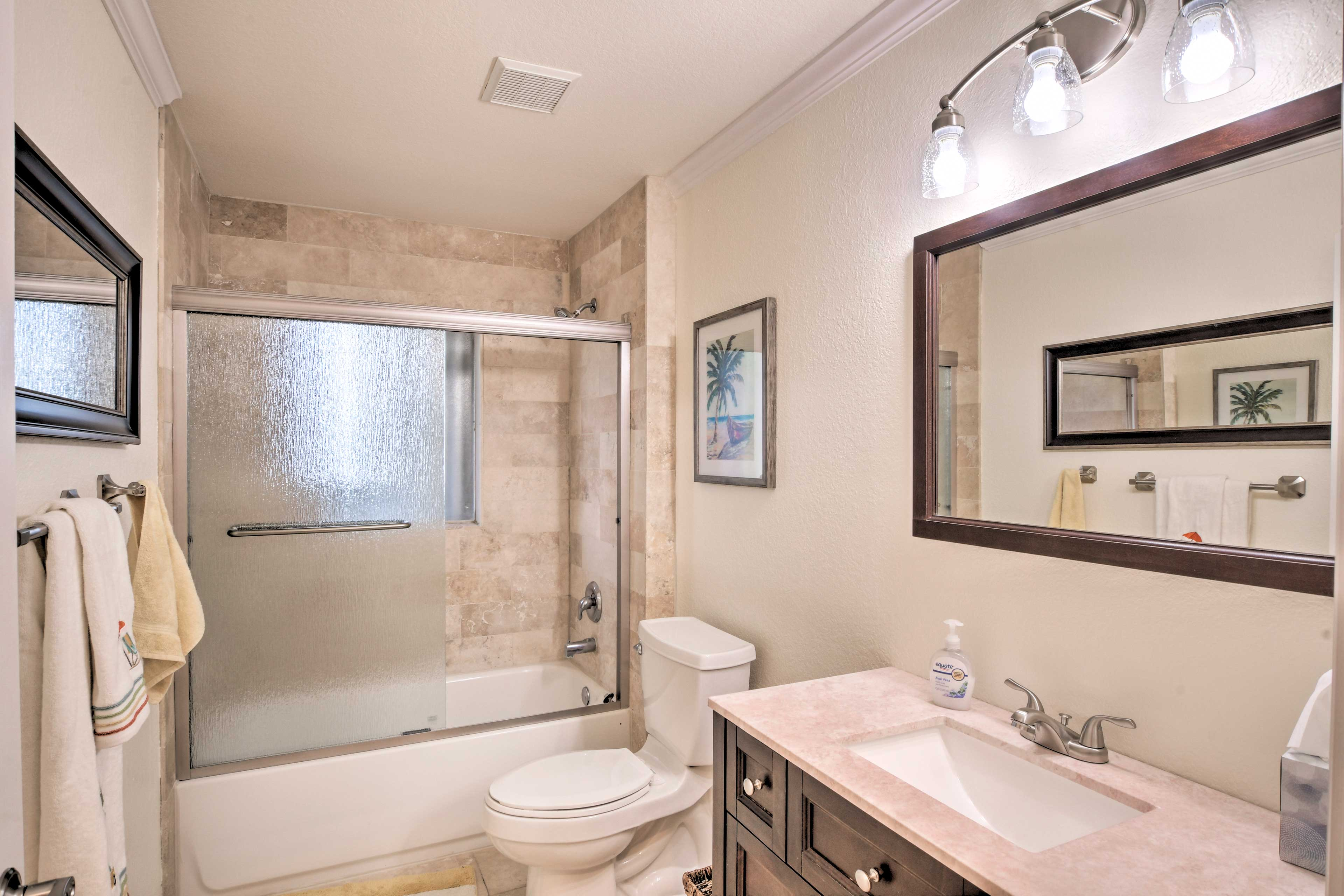 A shower/tub combo highlights this second bathroom.