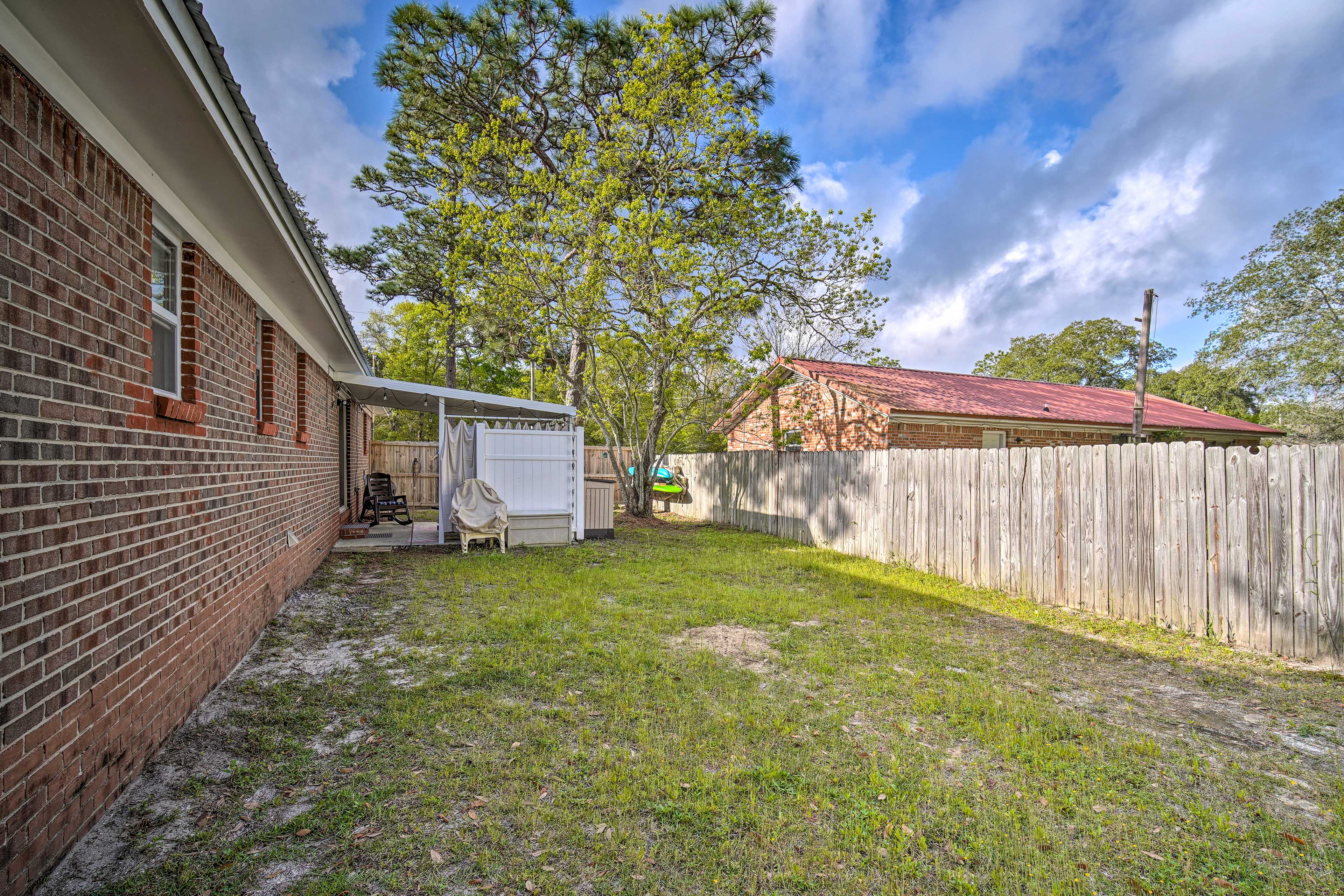 The large yard is surrounded by a privacy fence.
