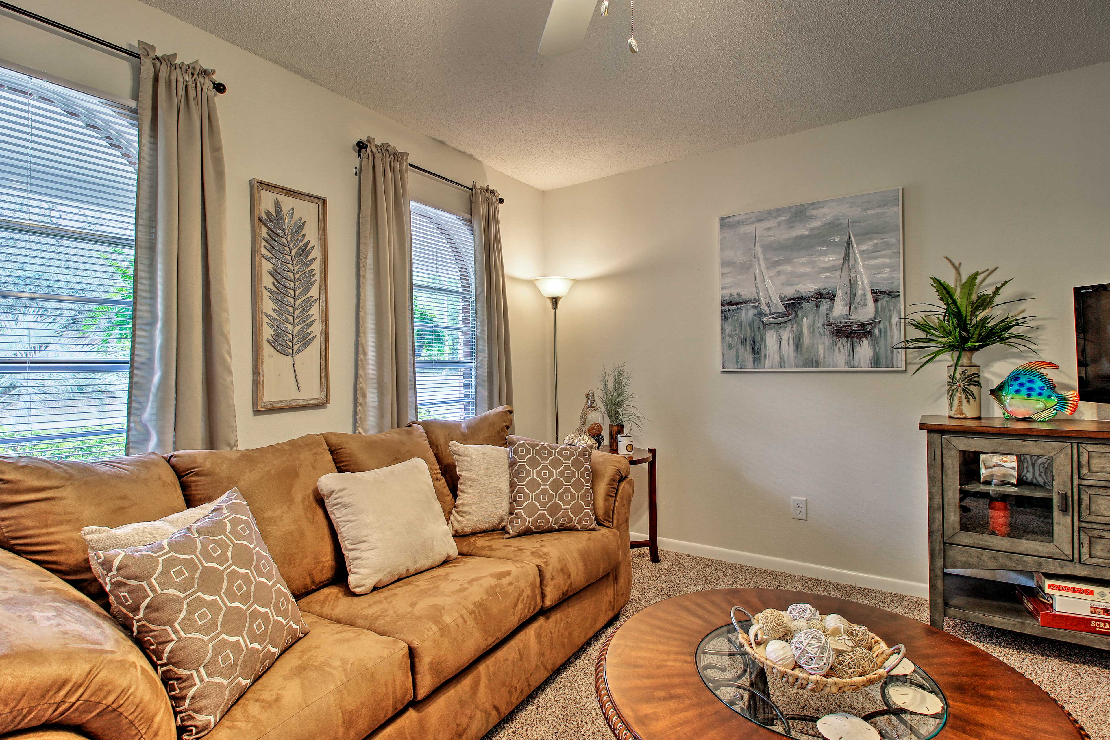 Lounge on the couch and enjoy the natural light beaming through the windows.