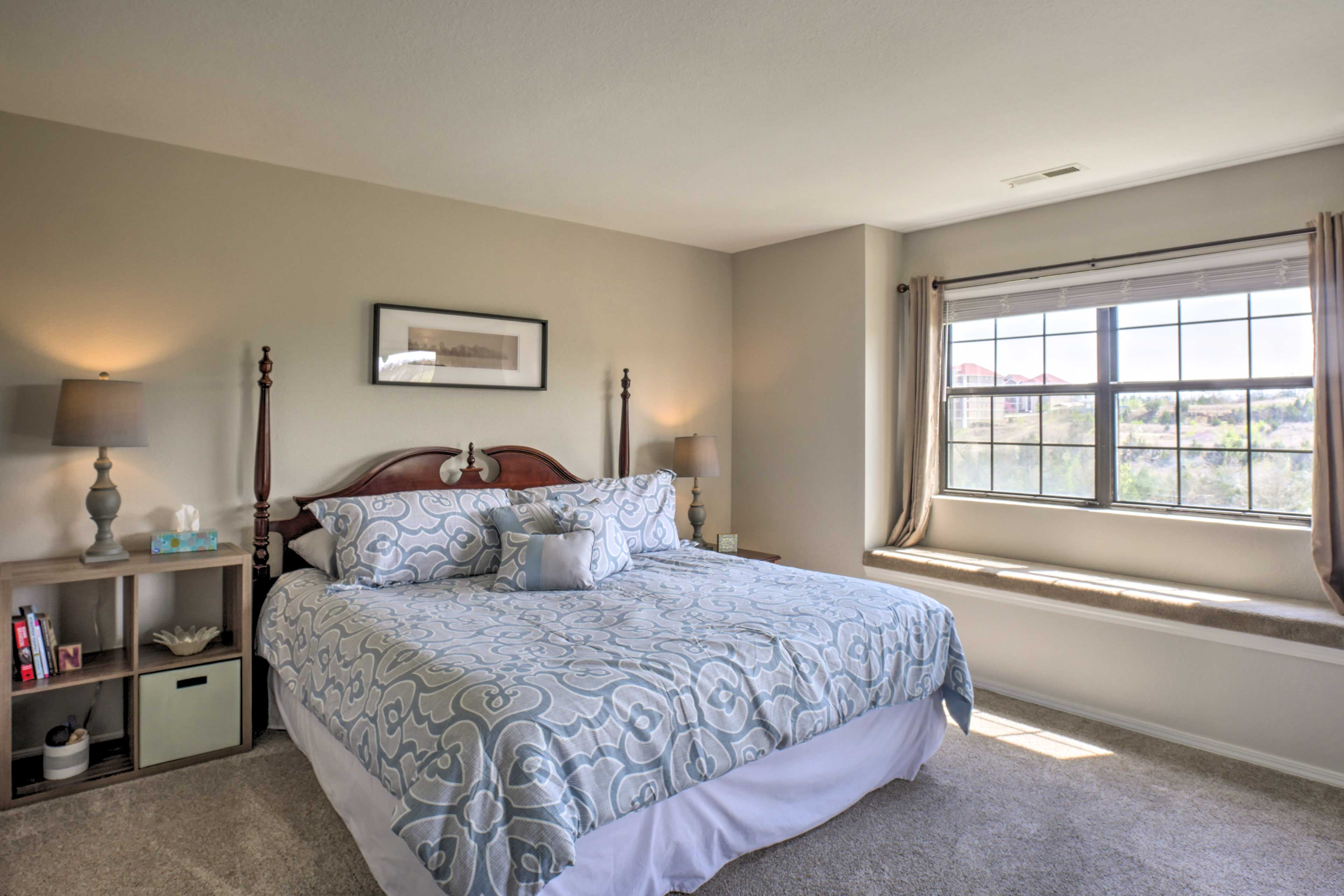 Rest your head on the king bed in the master bedroom.