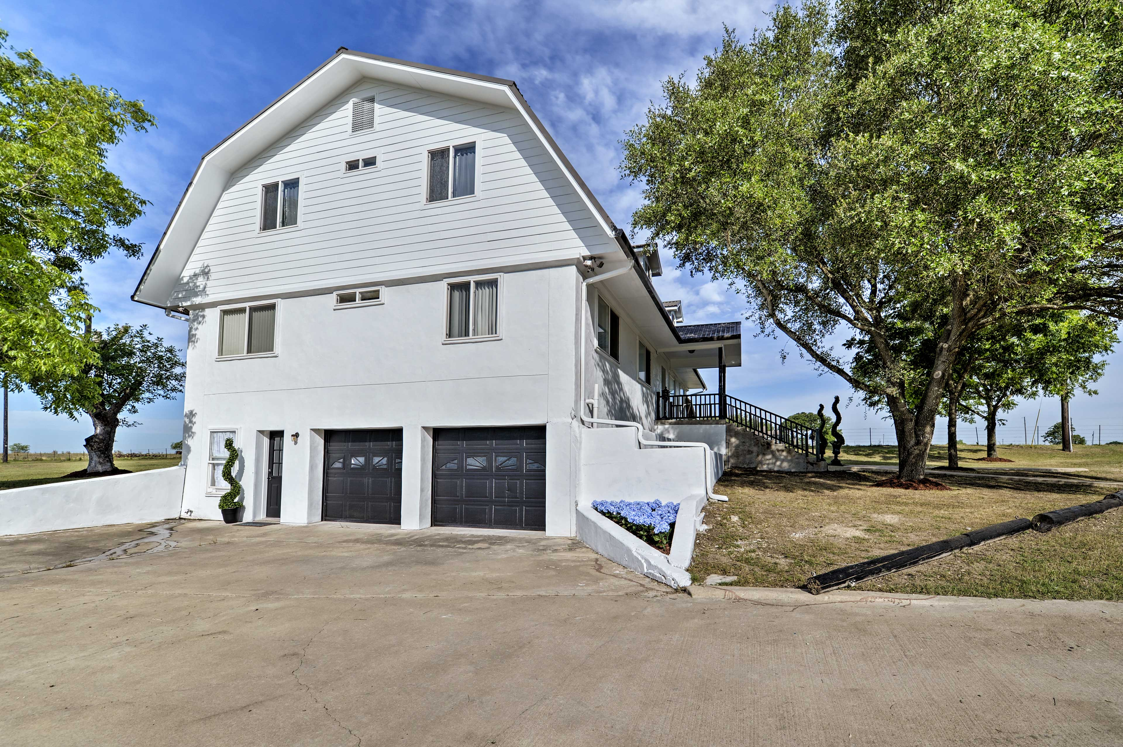 Ample driveway space adds convenience to your stay.
