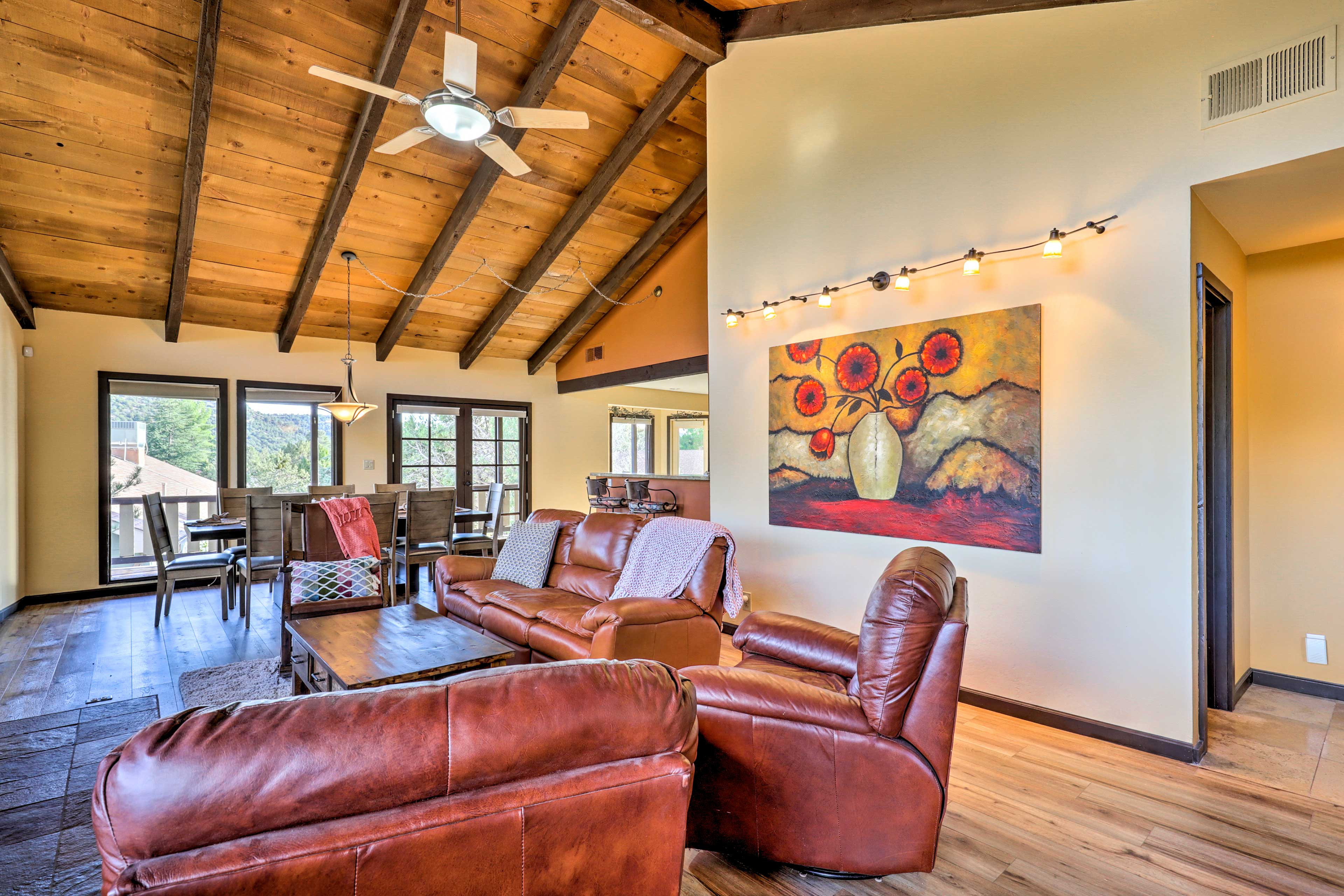 Vaulted ceilings and large windows make the living room feel very spacious.