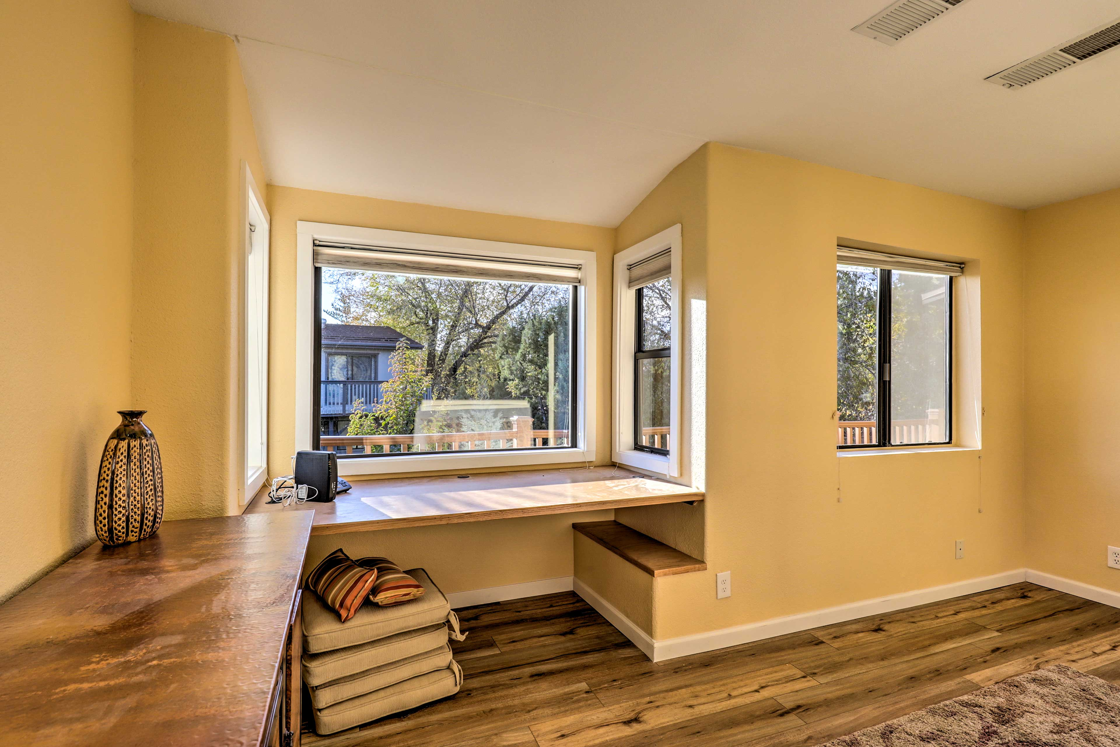 This house offers a desk with a view for those that need to get work done.
