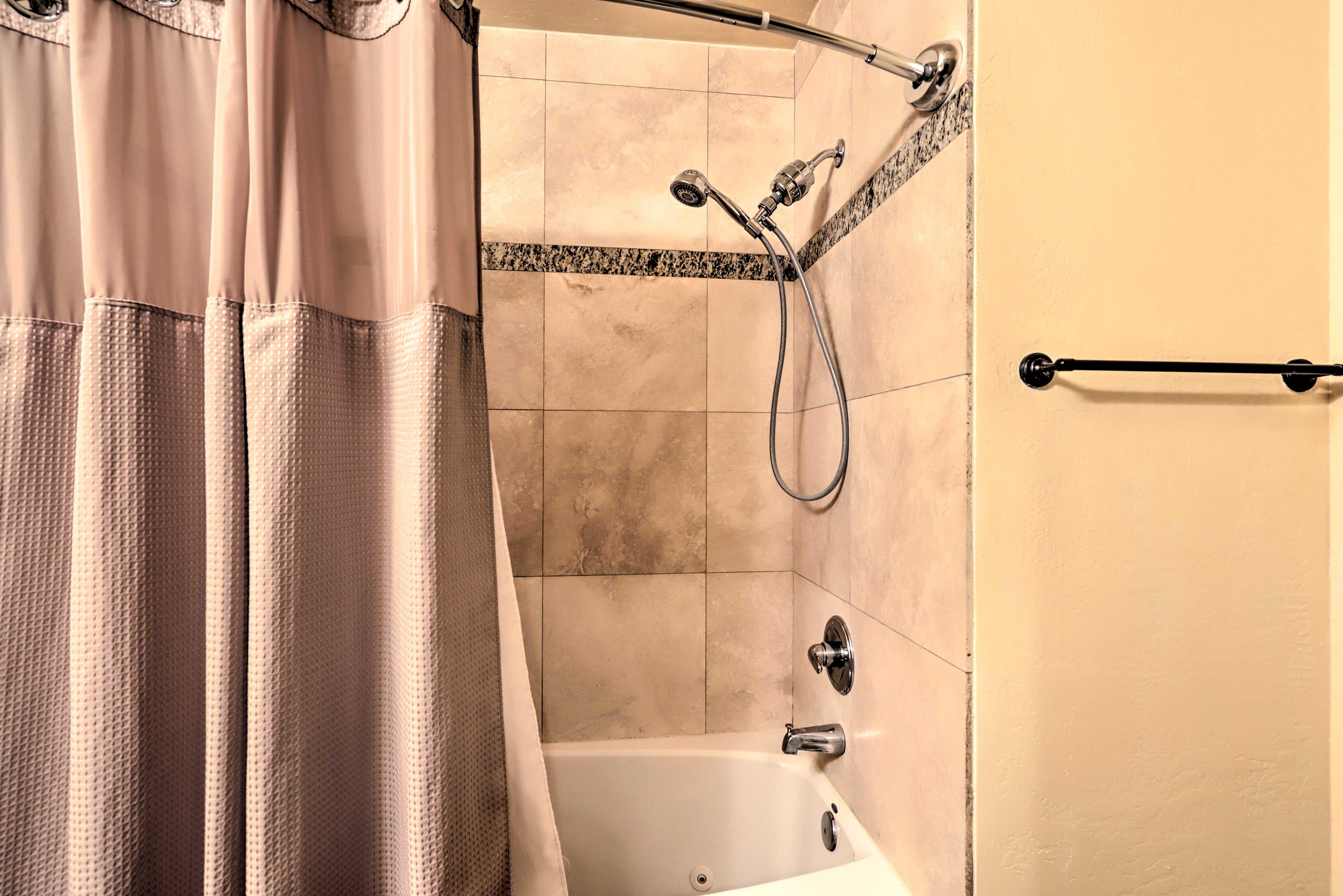 The en-suite master bath boasts tastefully designed tile work.