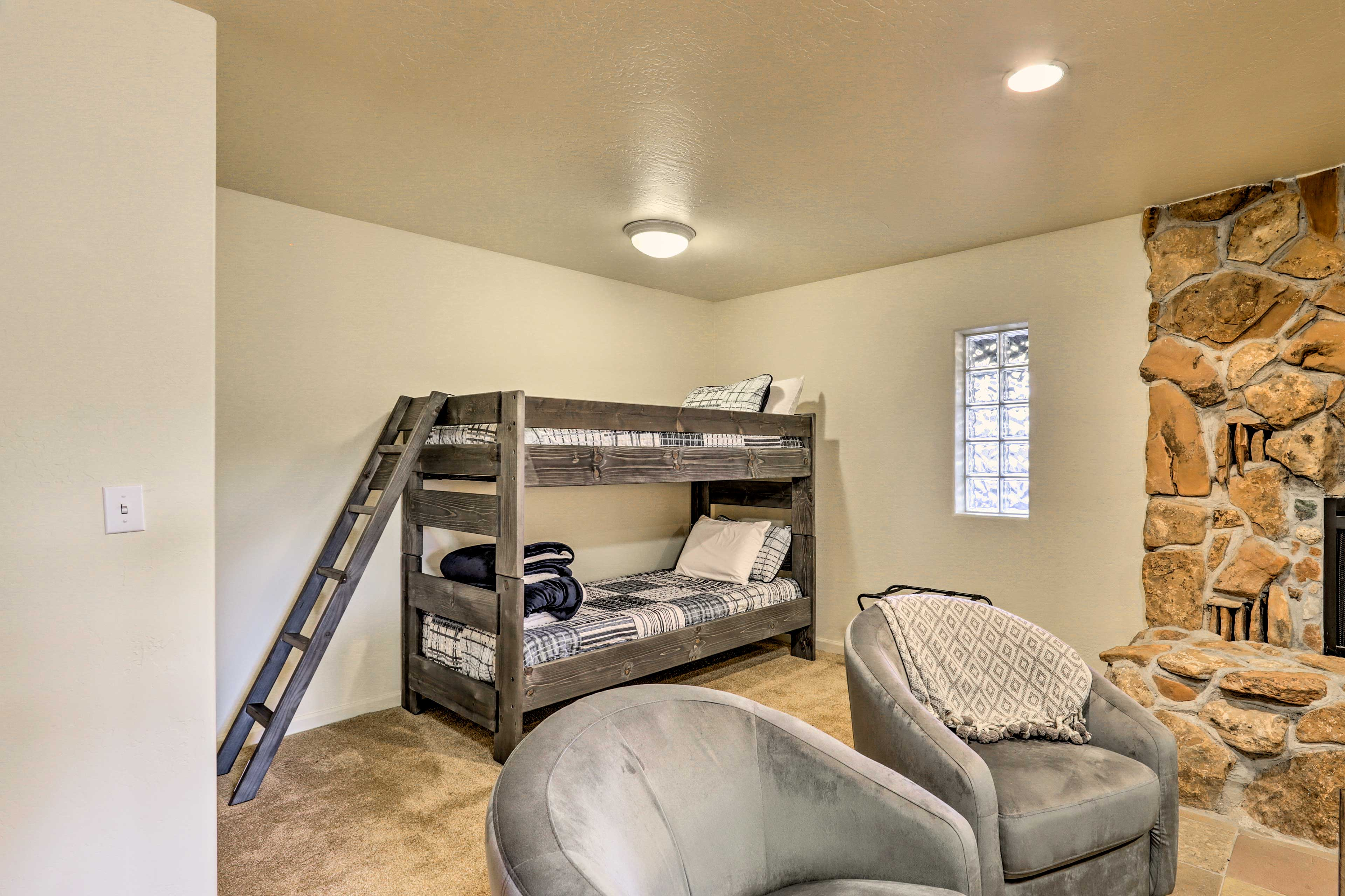 Twin bunk beds in the basement offer sleeping room for 2 more guests.