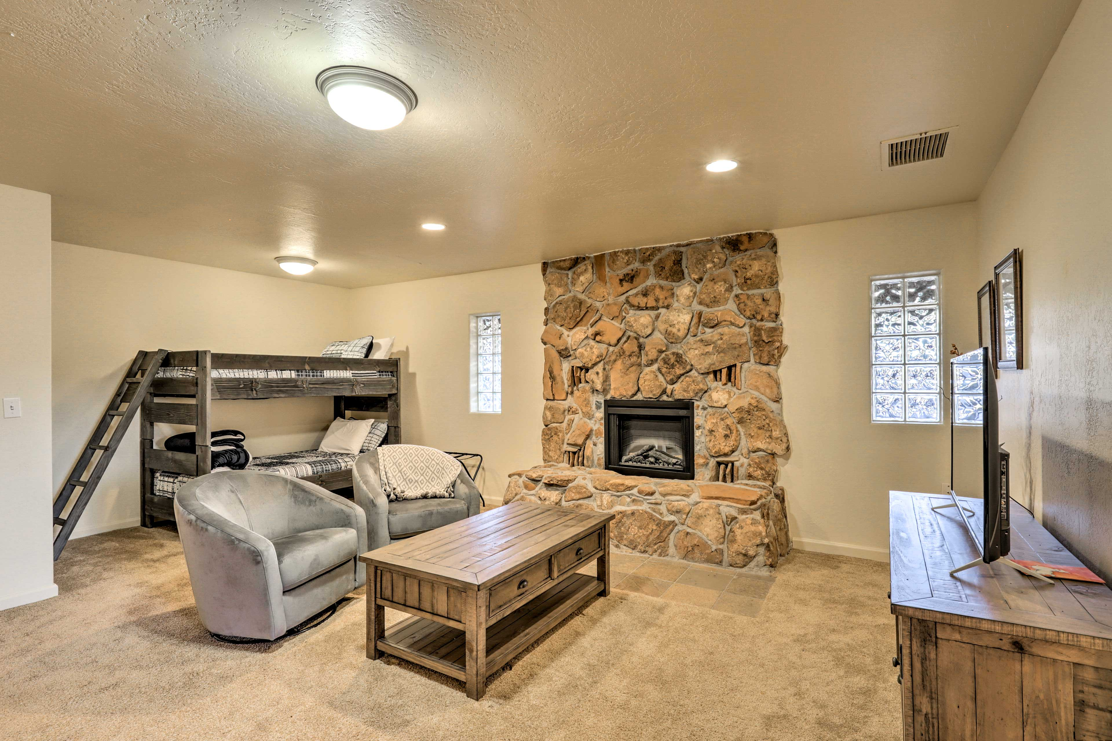 Warm up by the second fireplace in the finished basement.