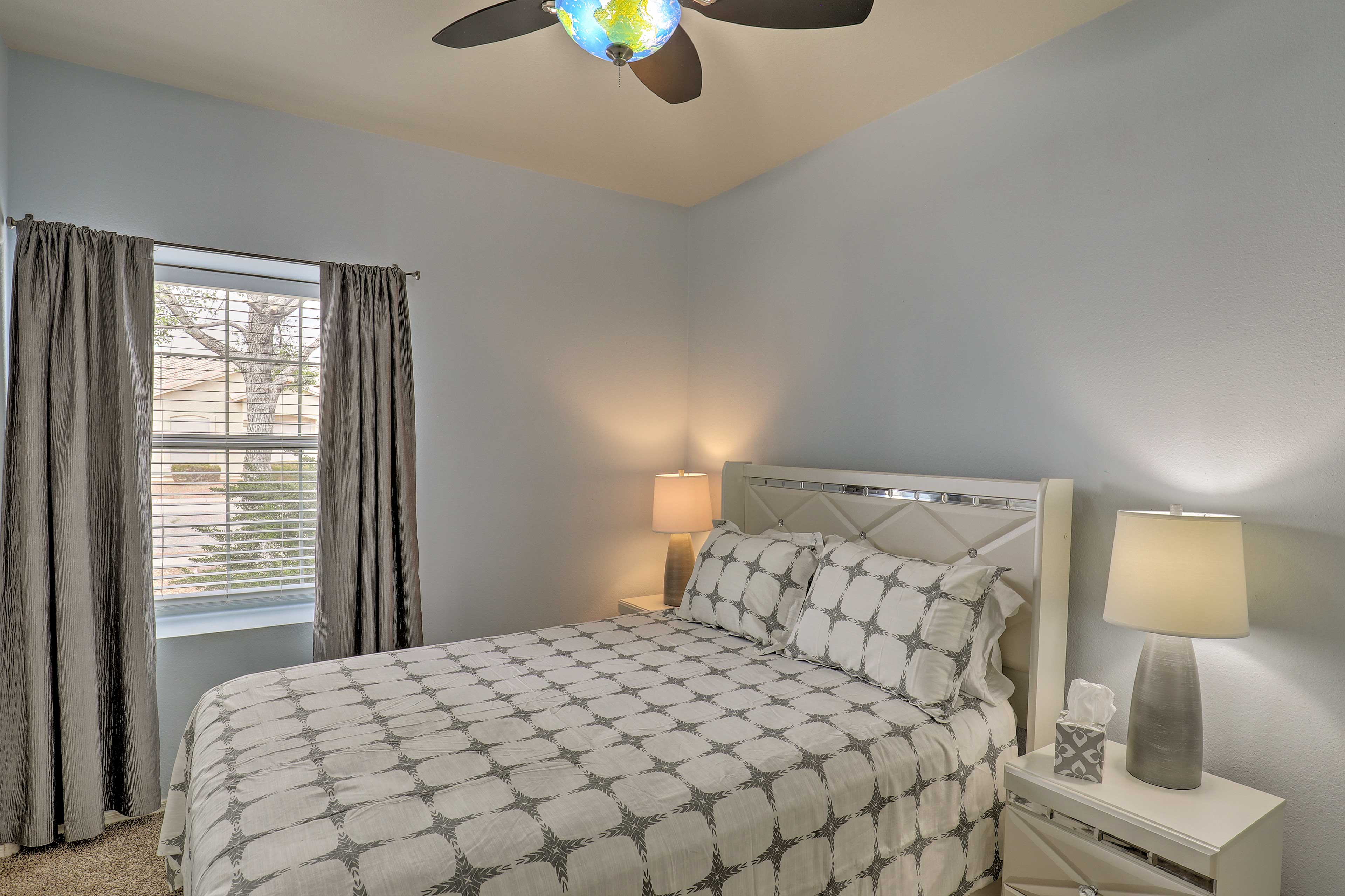 Admire the globe light fixture on the fan as you lay in bed.