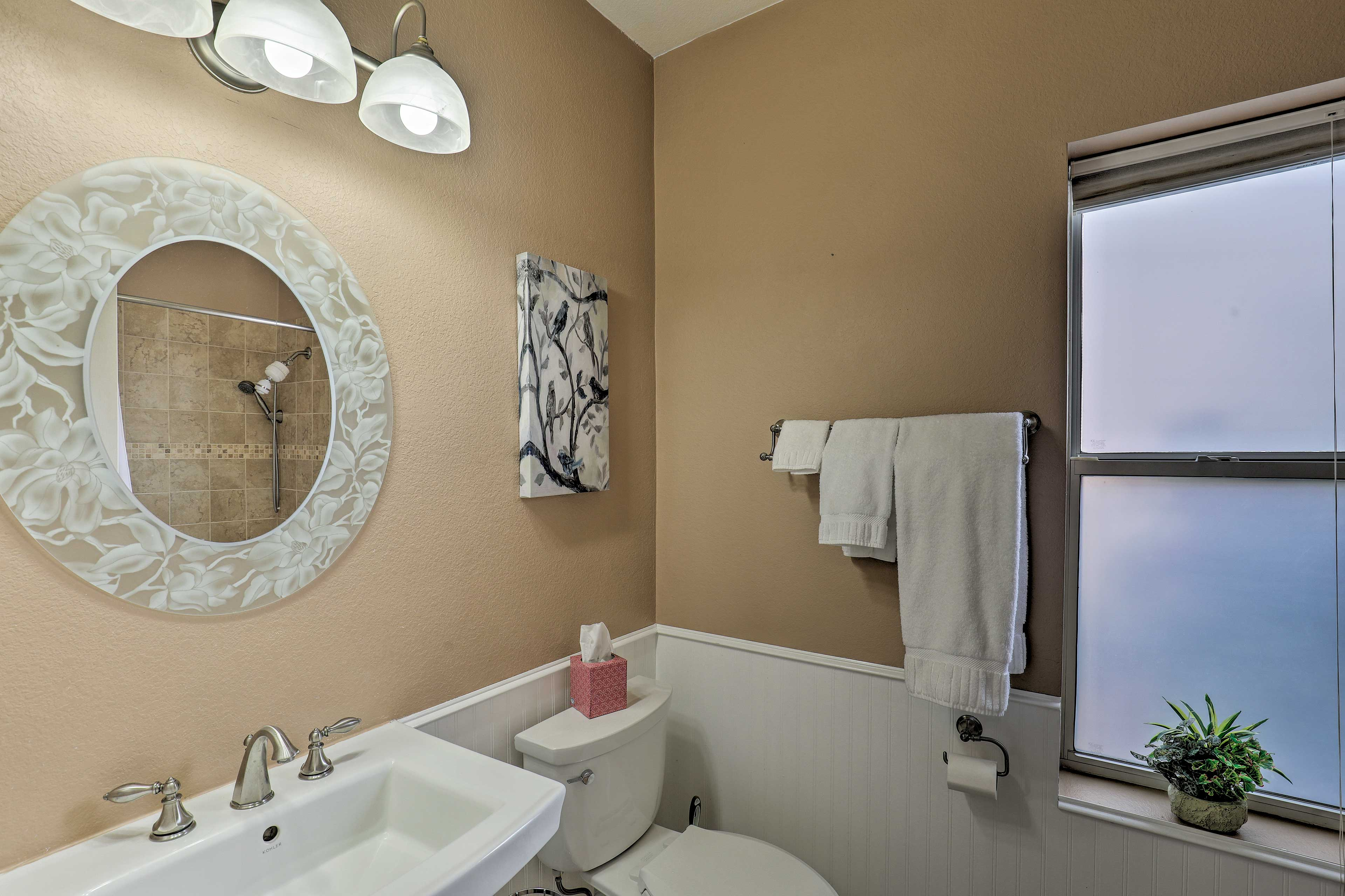 Freshen up in the bathroom each morning before heading to the common spaces.