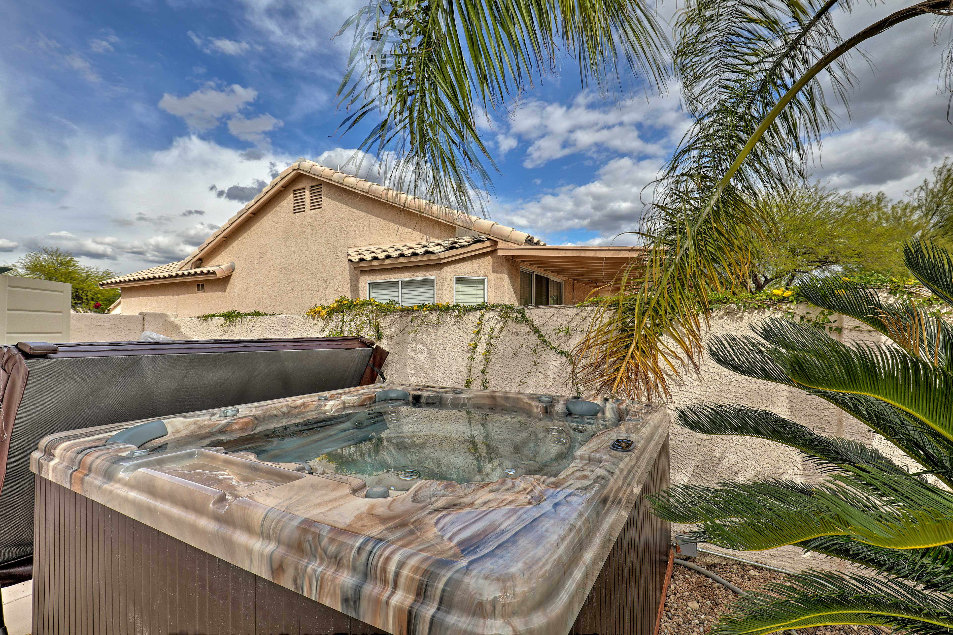 Soothe your muscles in the private hot tub after exploring Saguaro National Park