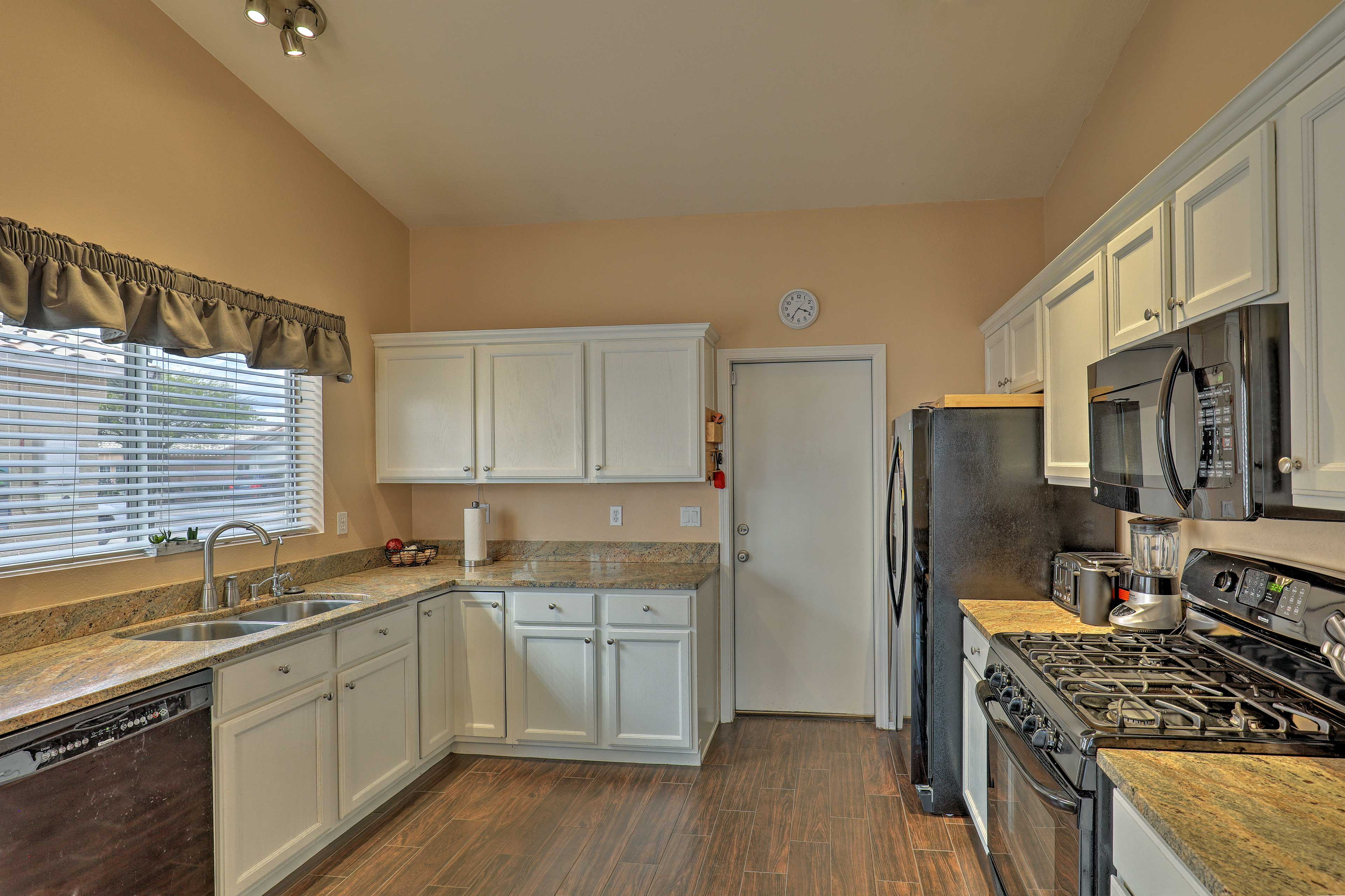 The kitchen offers ample counter space for all your cooking needs.