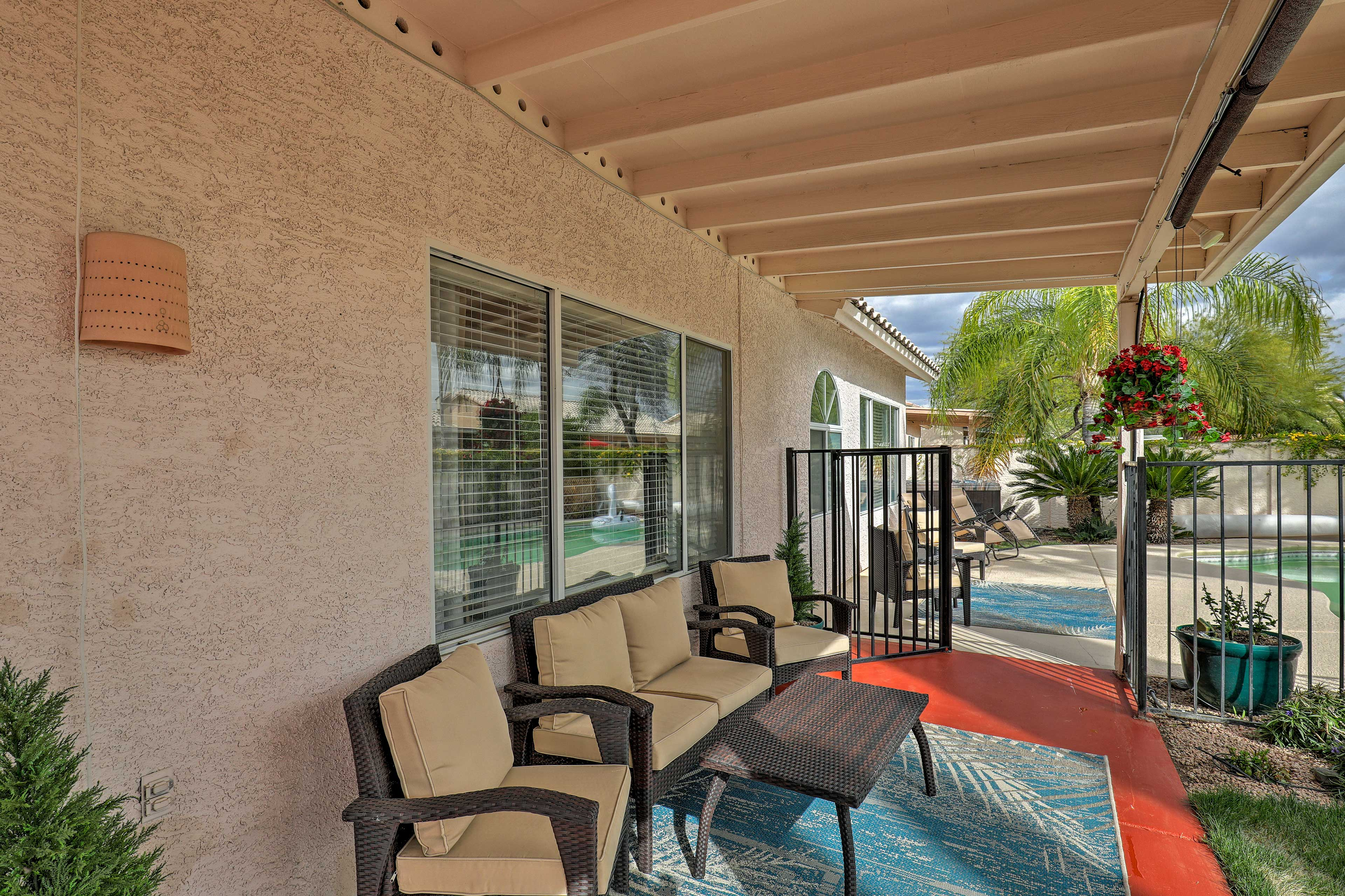 Sip your morning coffee from this covered patio space.
