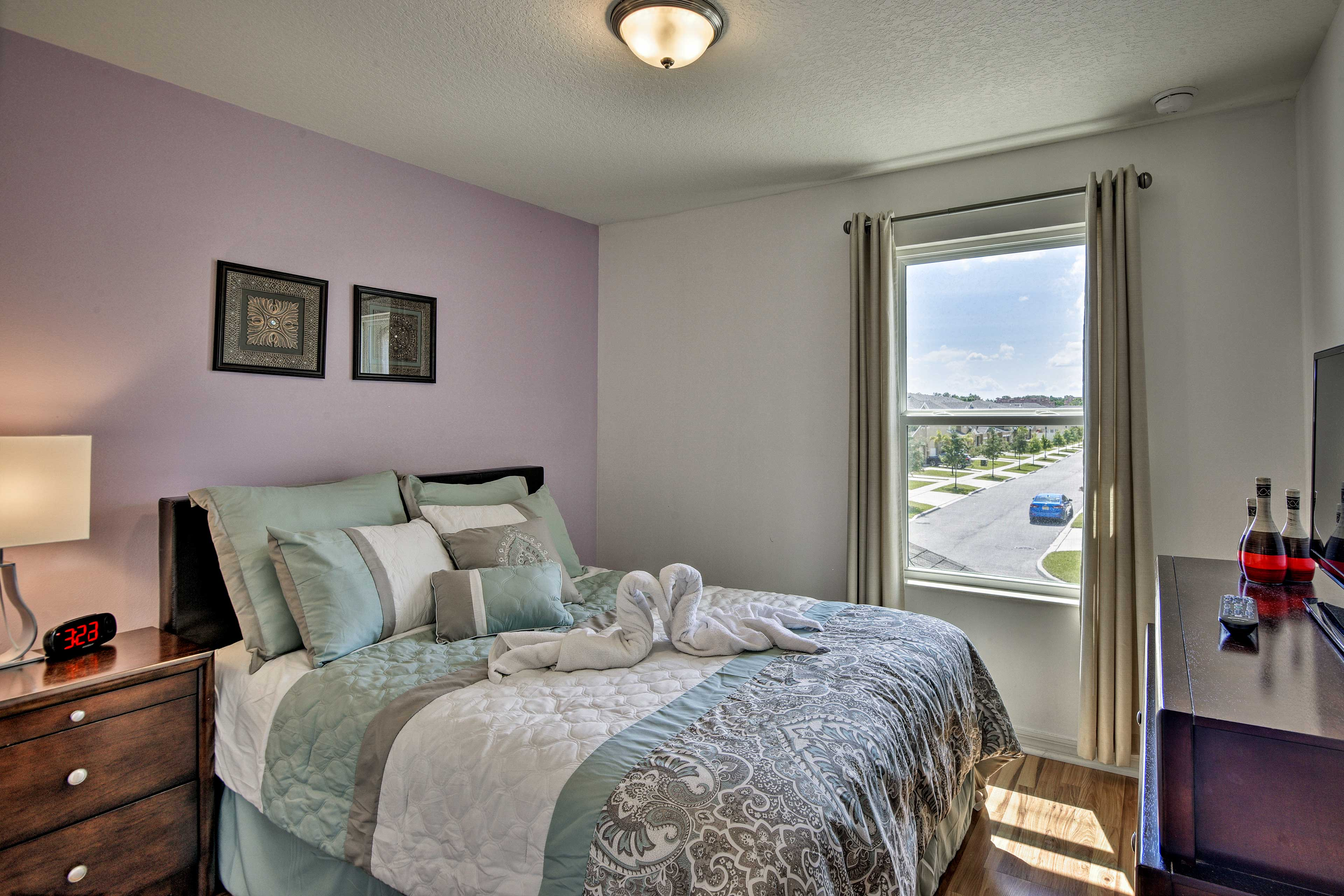 You'll find a queen bed in this bedroom.
