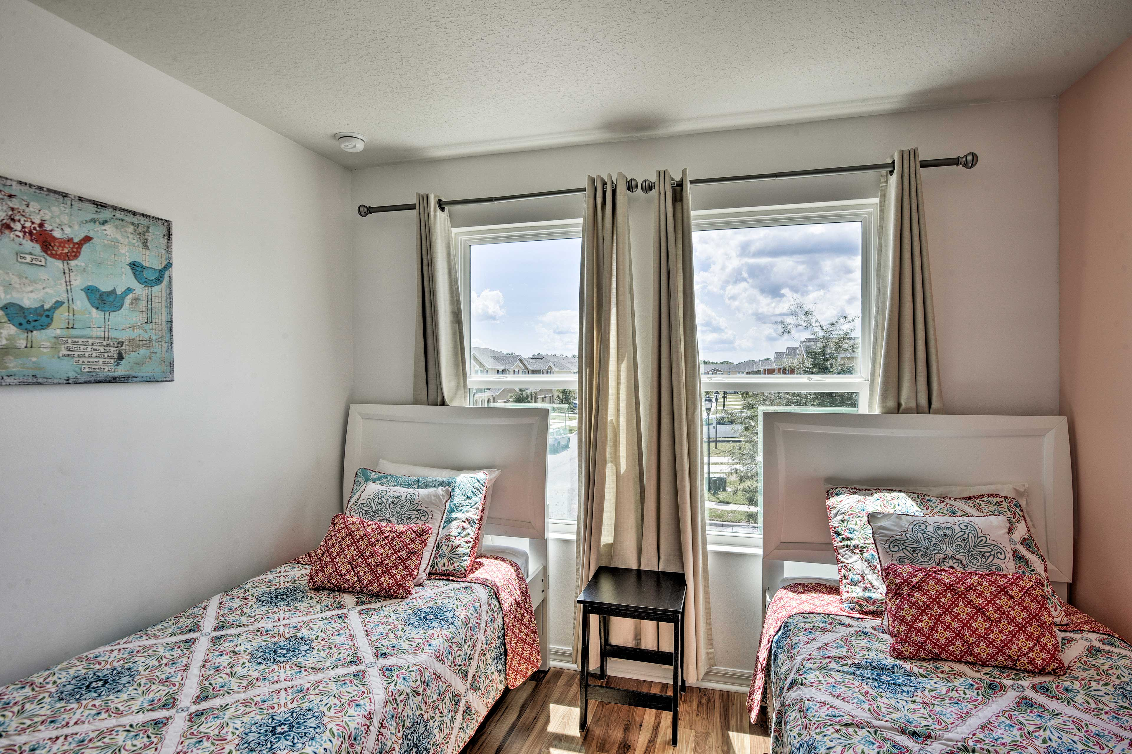 The last bedroom also offers a set of twin beds.