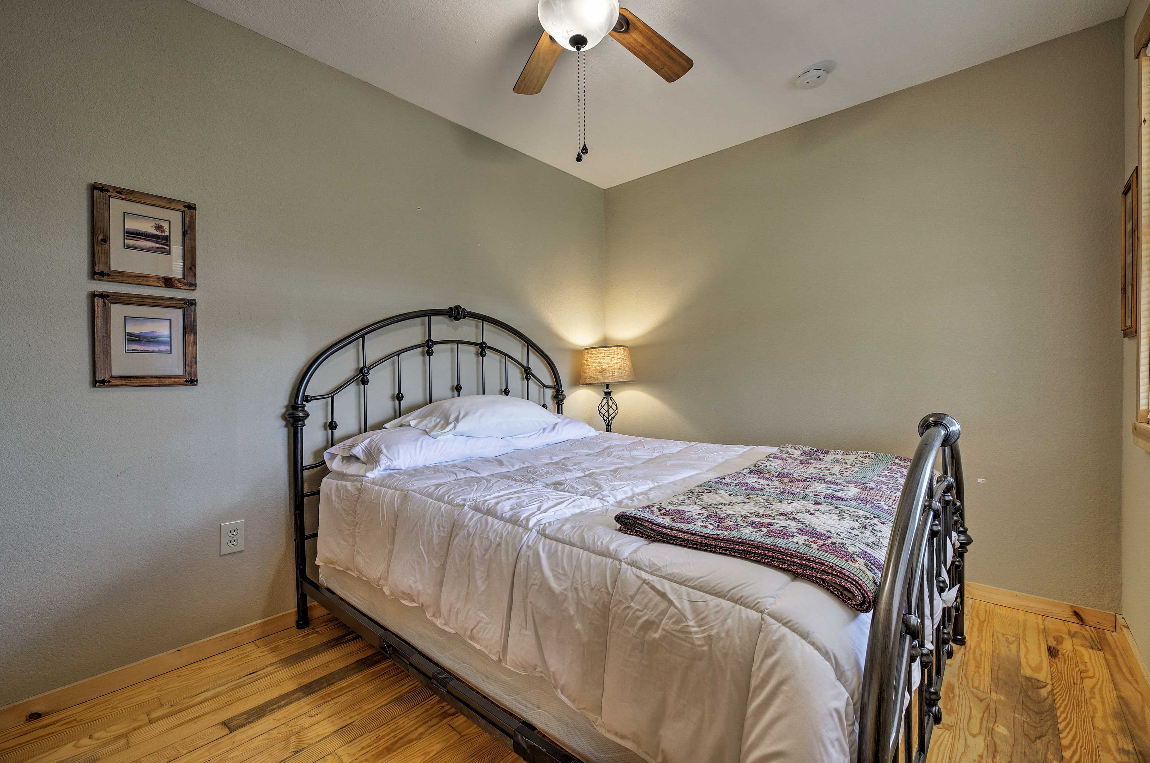 The second bedroom also hosts a queen bed.