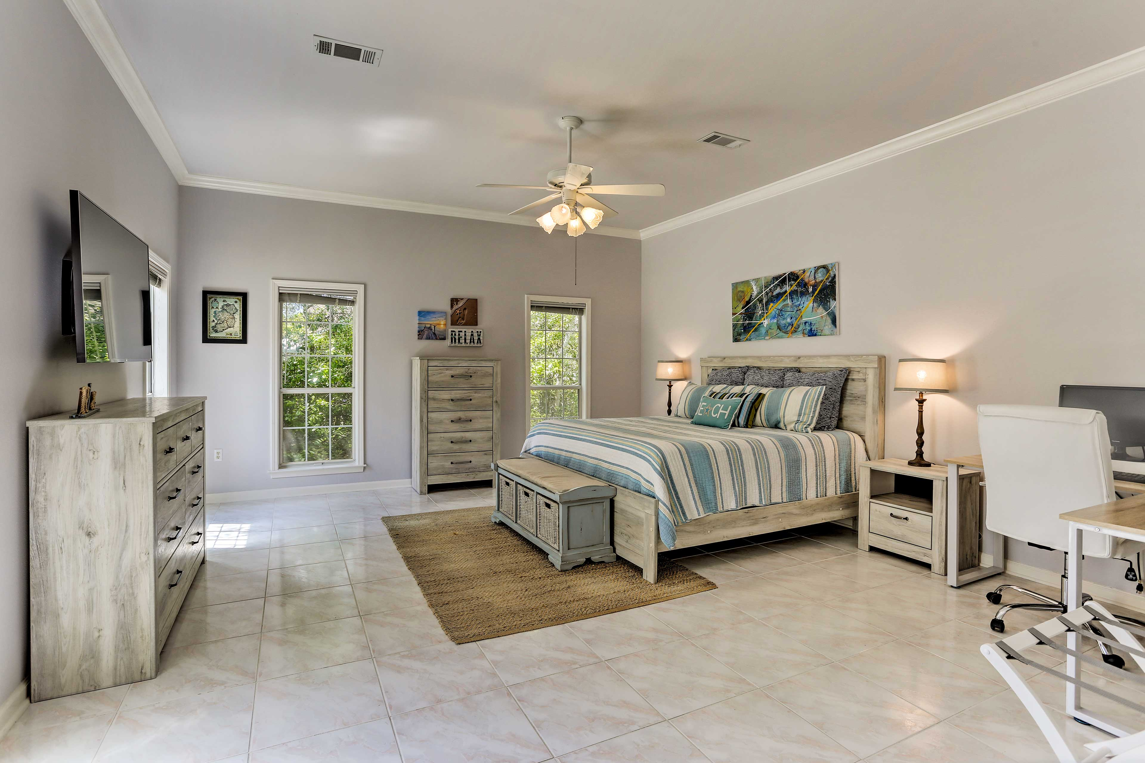Two lucky guests can claim the expansive master bedroom.