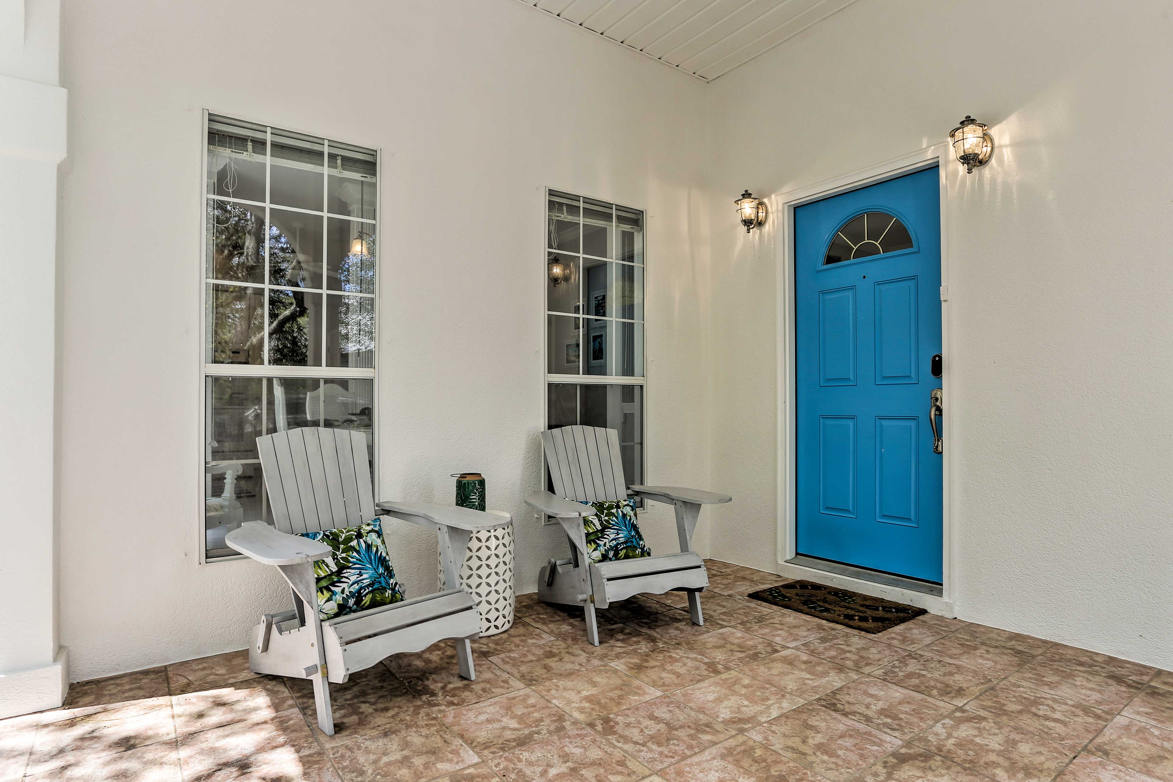 Open the charming bright blue door to begin your stay.