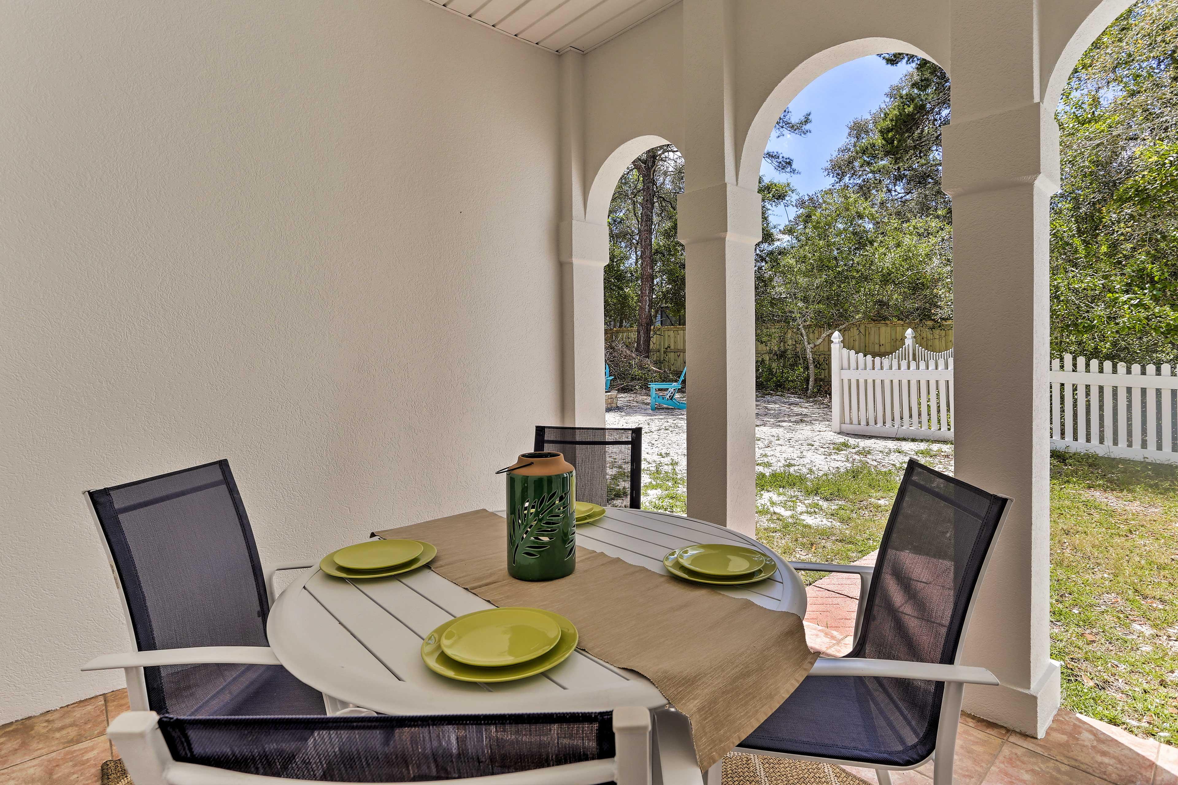Dine al fresco at the 4-person patio table!