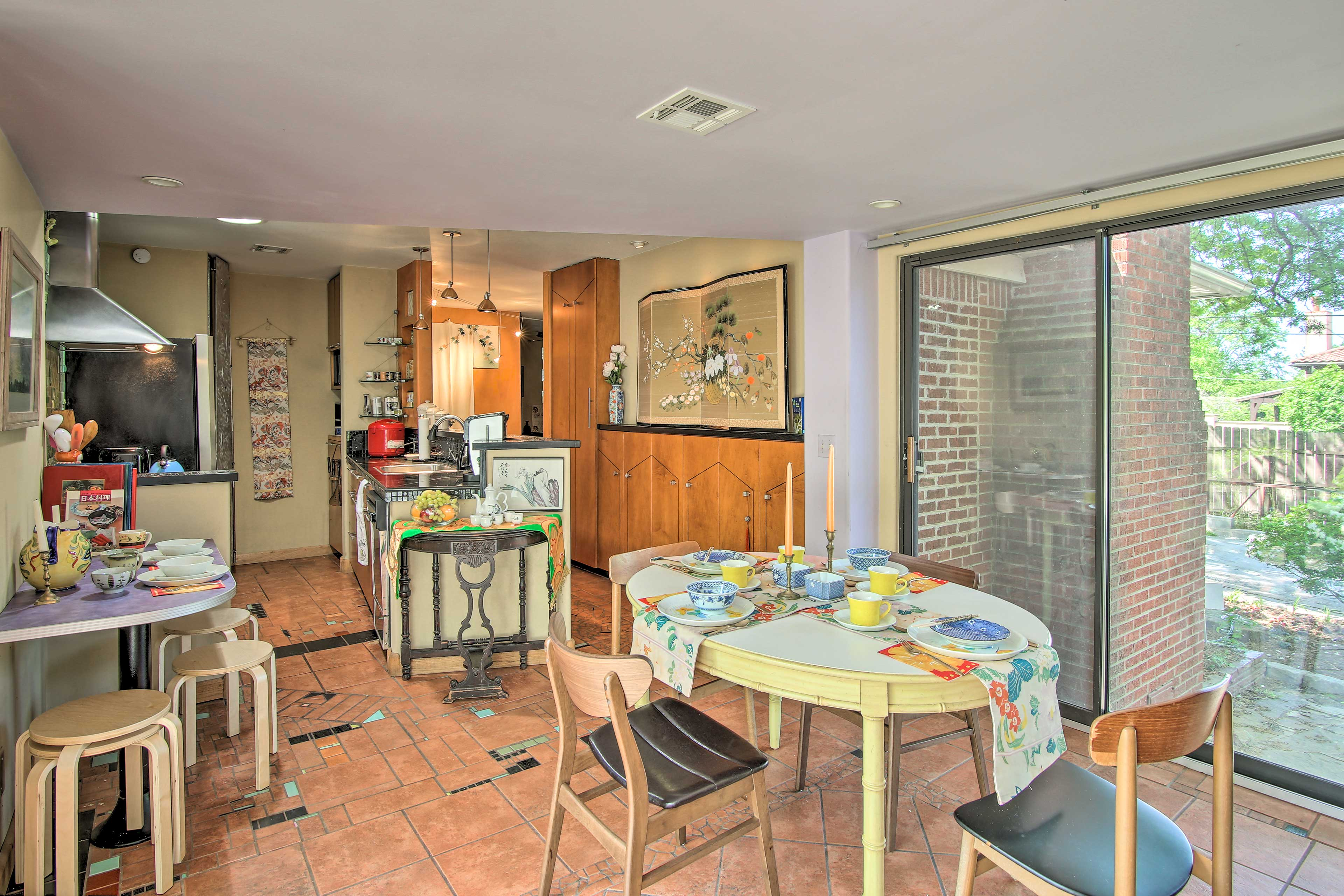 Gather around the main dining space and use the breakfast bar for extra seating.