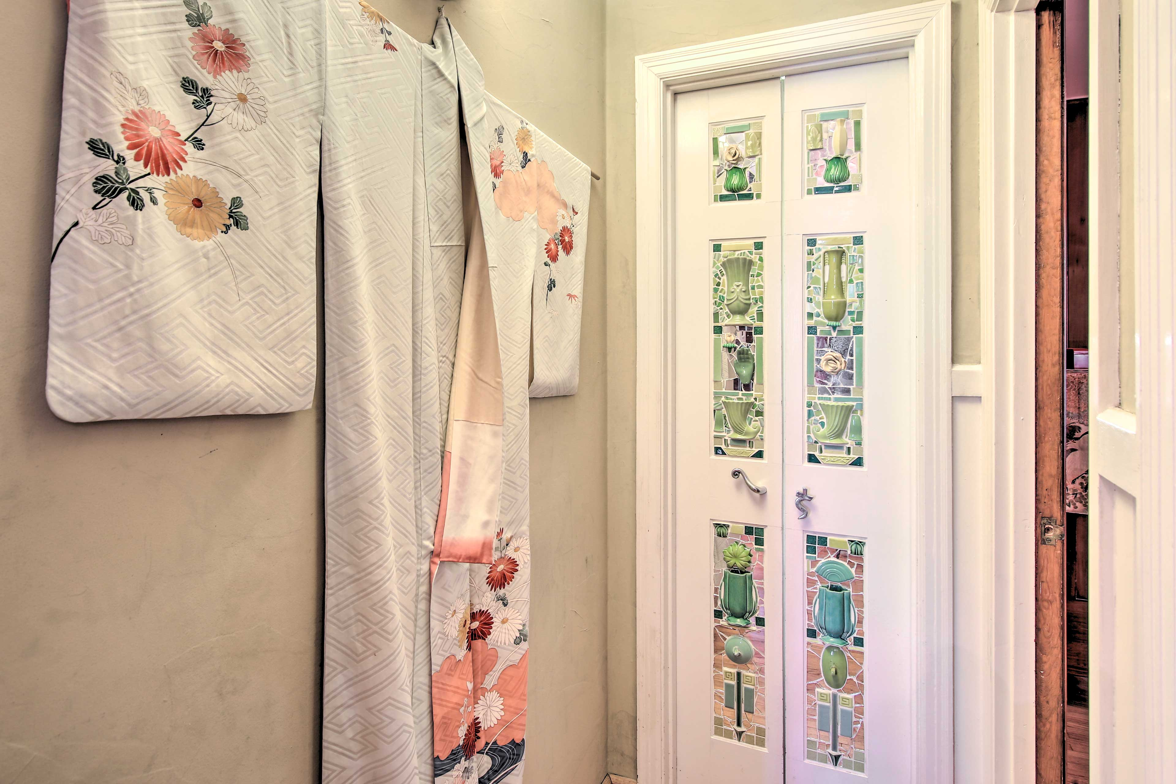 Beyond these colorful doors is the second full bathroom.