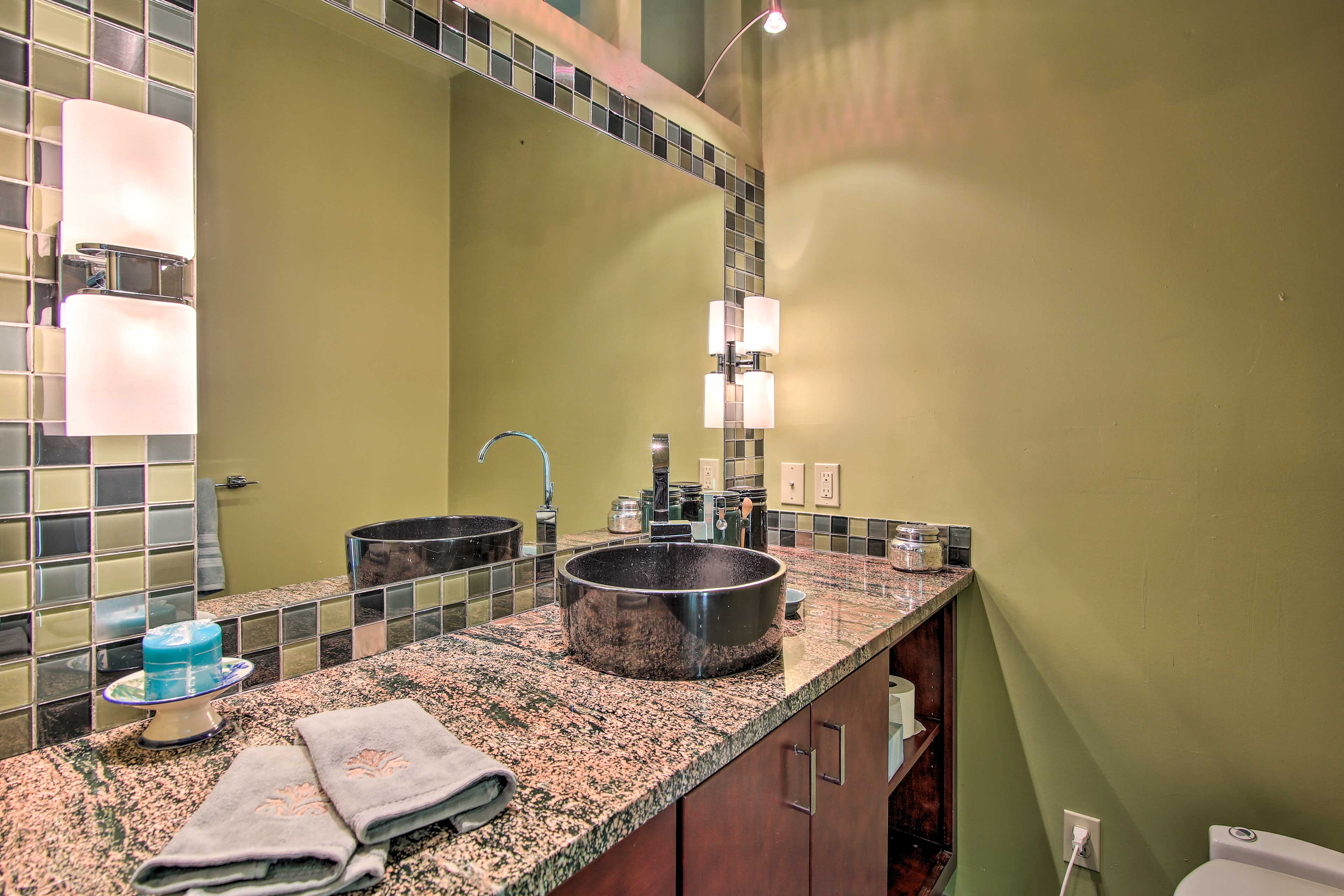 Rinse off in this full bathroom after your daily adventures.