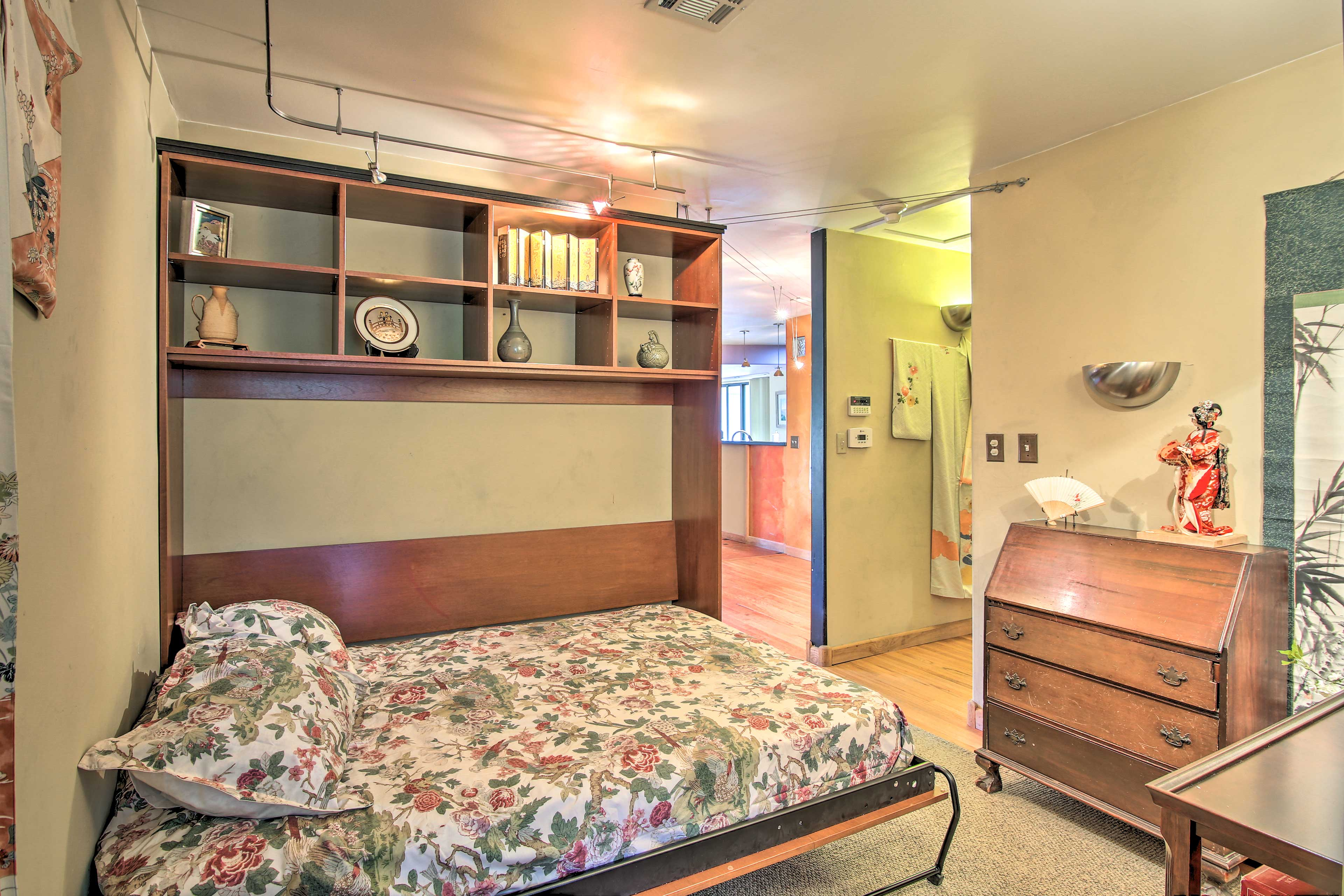 Pull down the full Murphy bed for extra accommodations in the game room.
