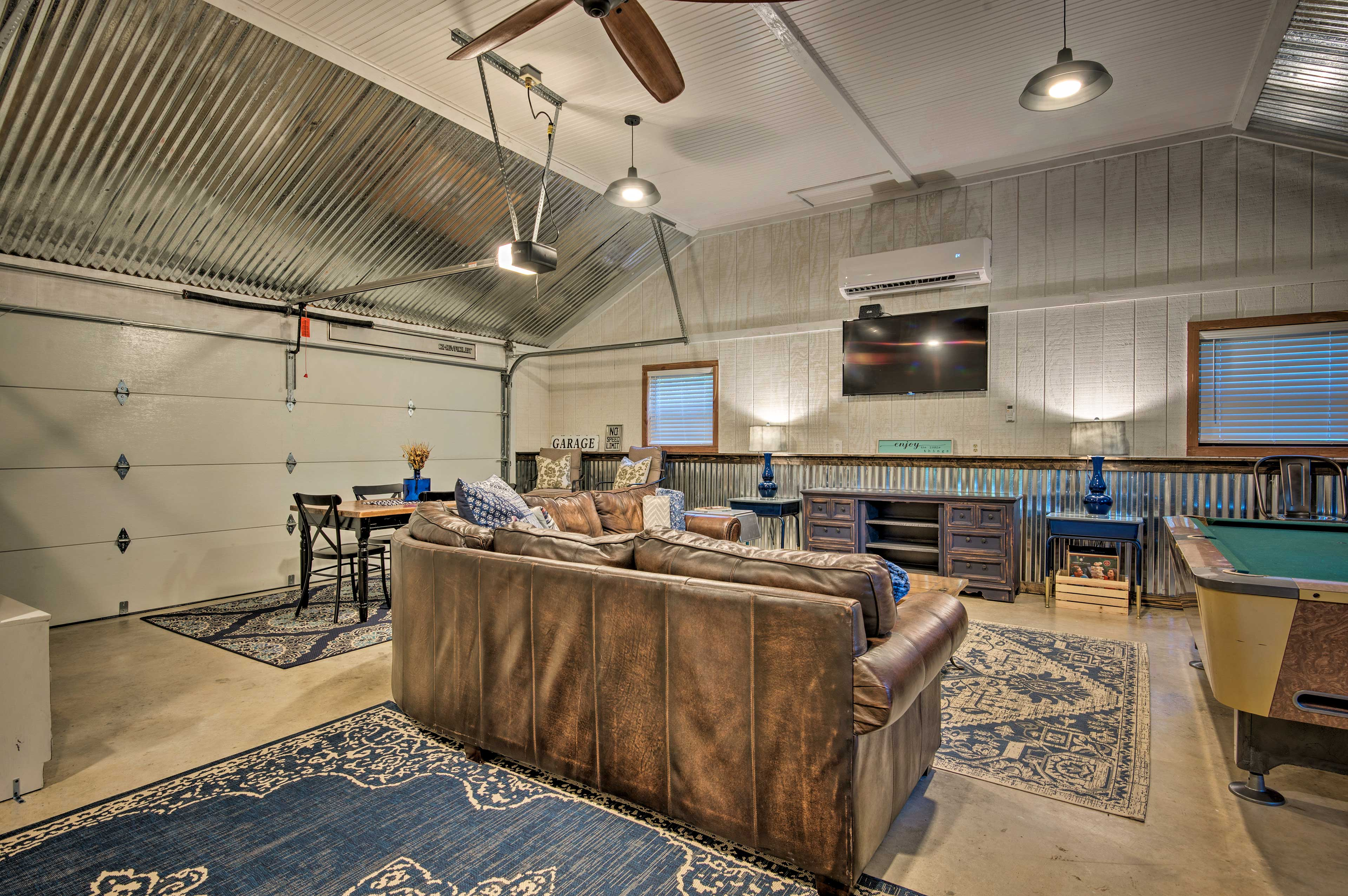 The game room features a large flat-screen TV and pool table!
