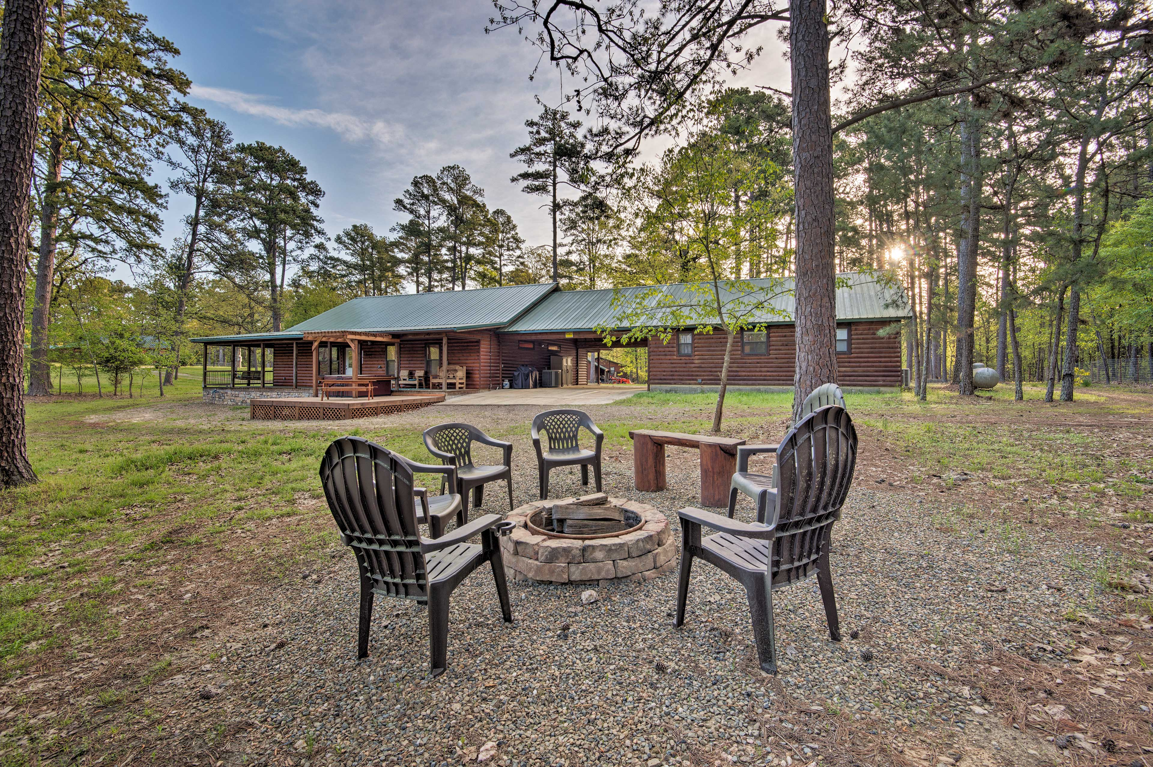 This 3-bed, 3-bath home features quintessential cabin amenities like a fire pit!
