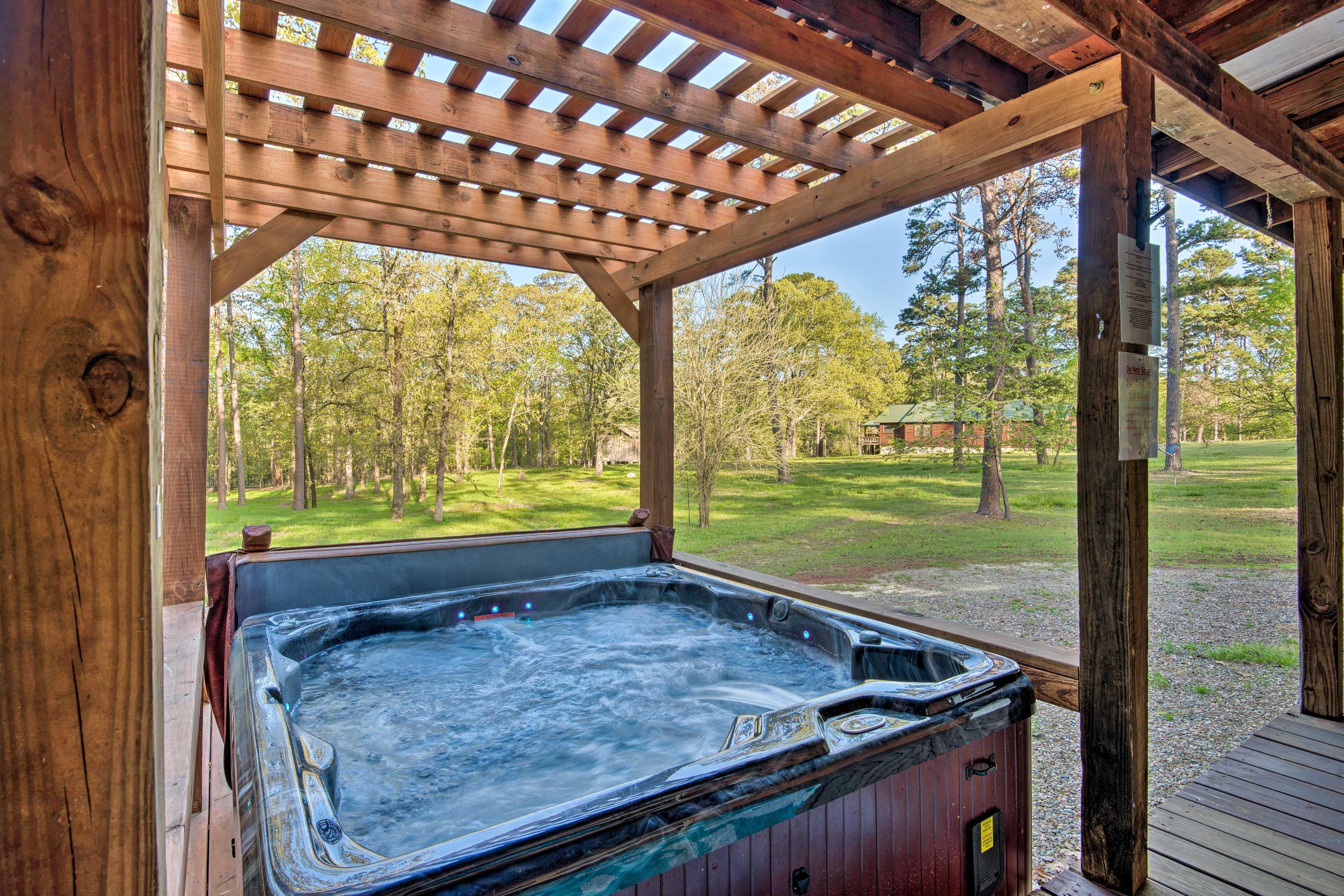 Soak away all of your cares in the cabin's private hot tub.