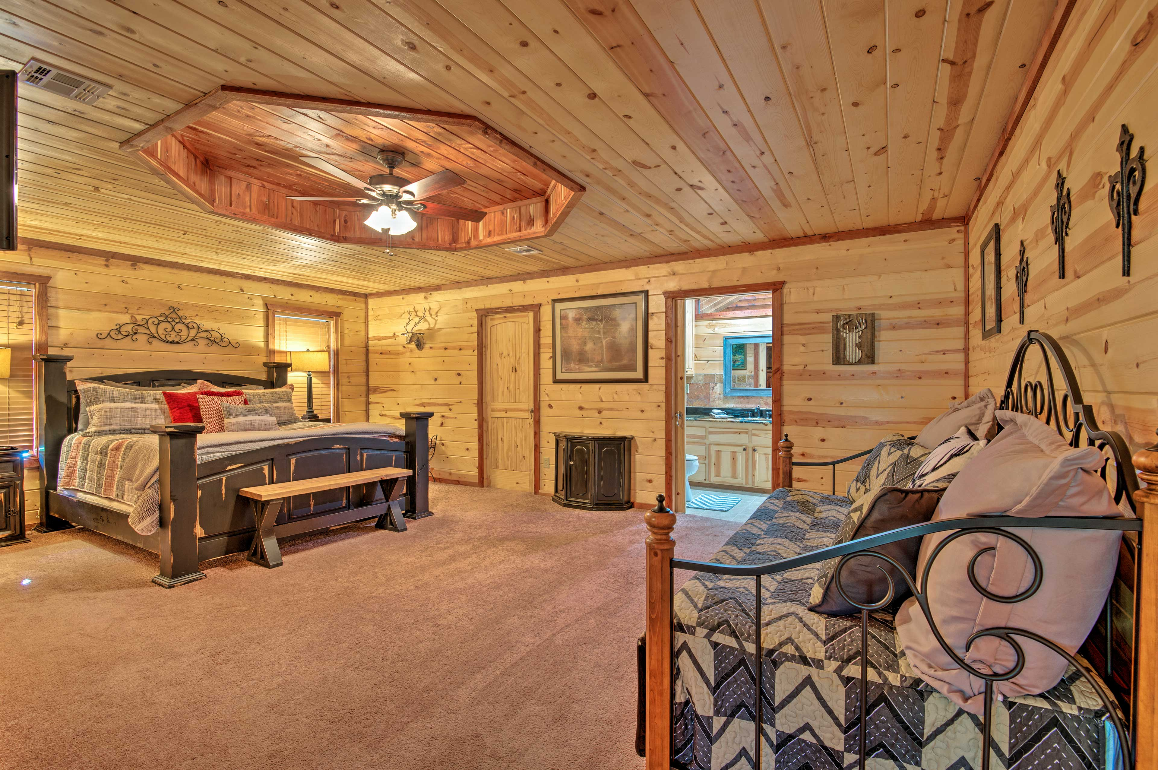 The bedroom features both a king bed & twin daybed that has a full trundle bed.