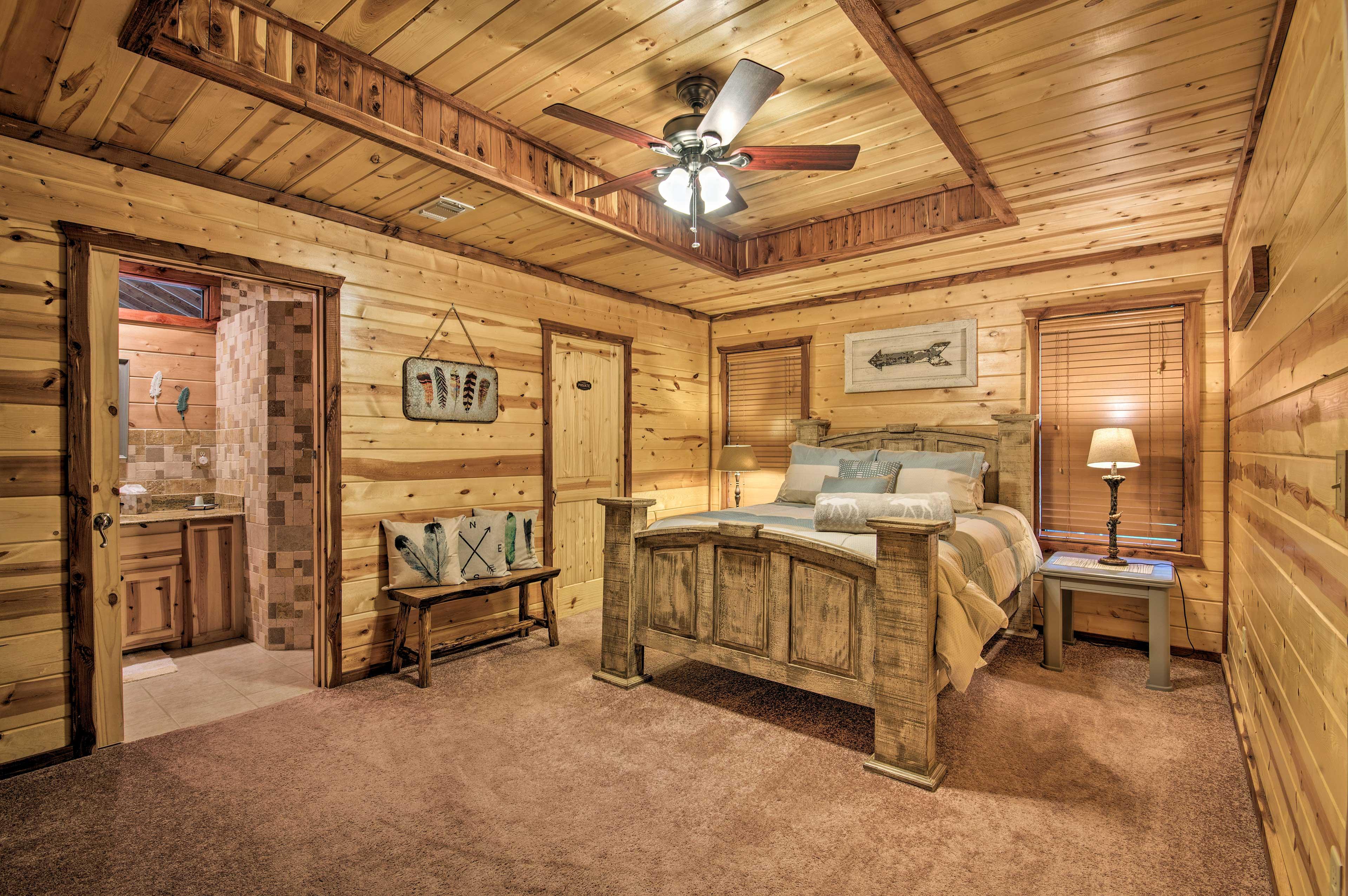 The second bedroom features a cozy queen bed, plus an en-suite bathroom.