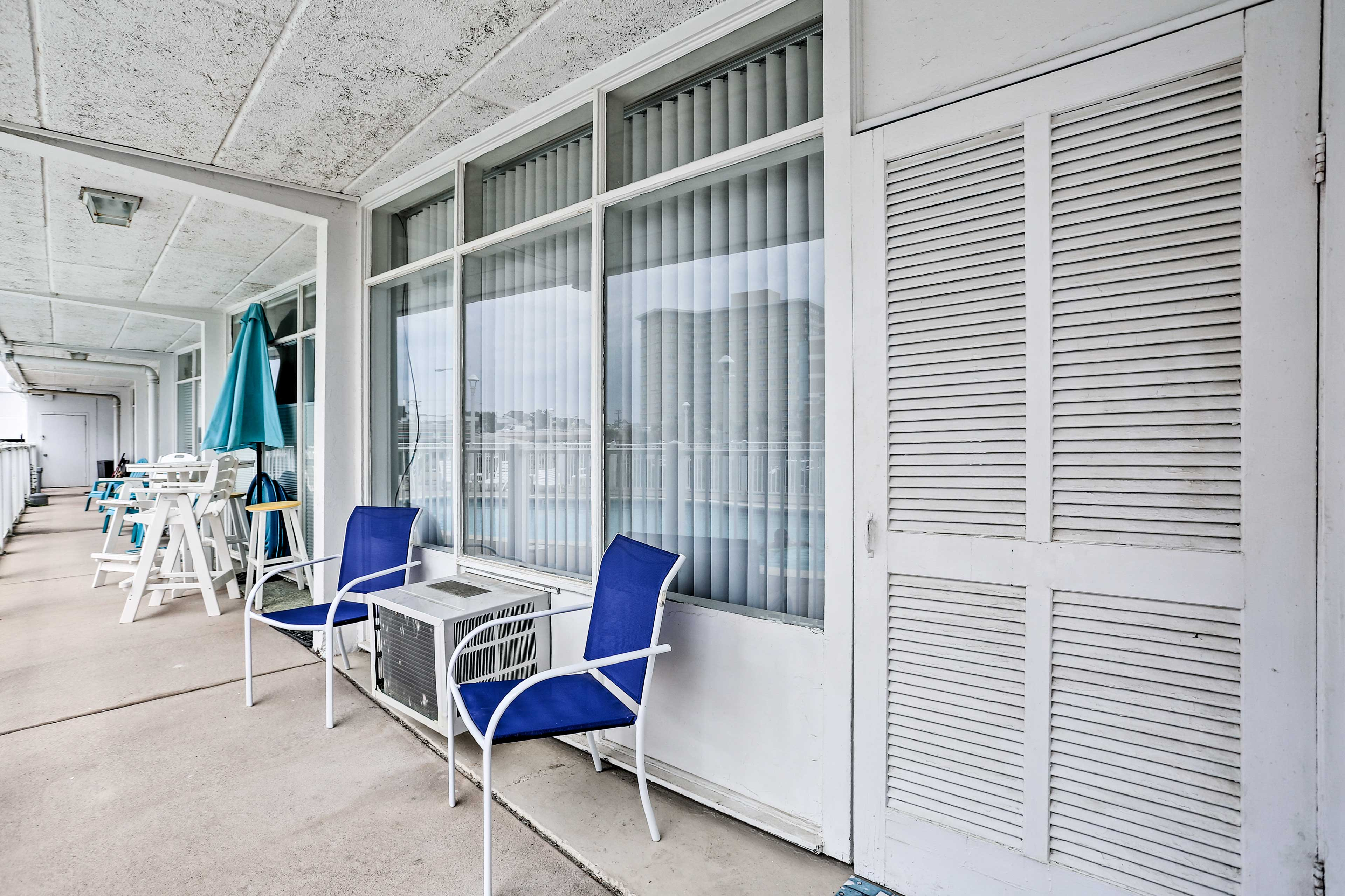 Boast about your patio spot overlooking the pool at this studio!