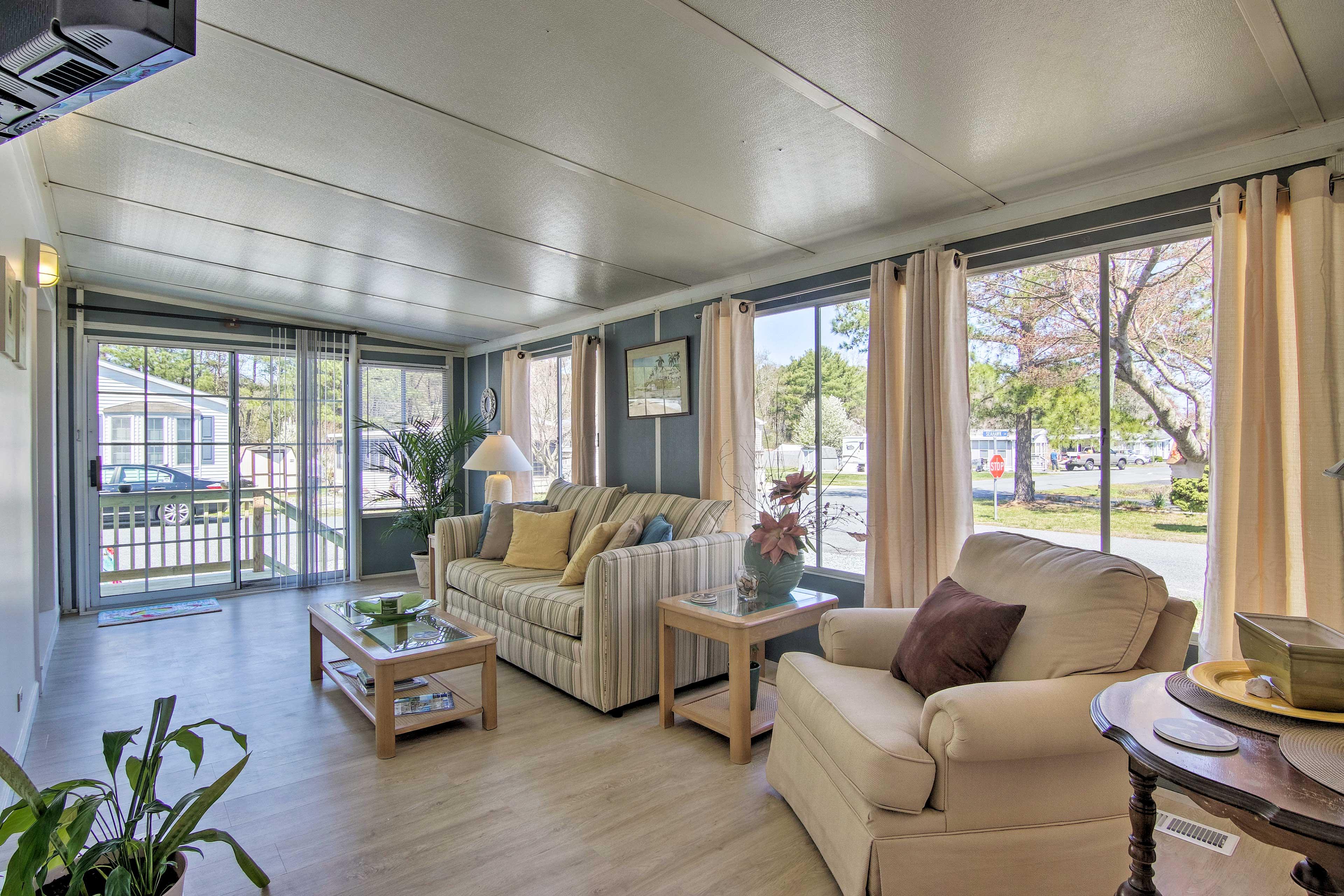 An abundance of windows illumiante the modern living space.