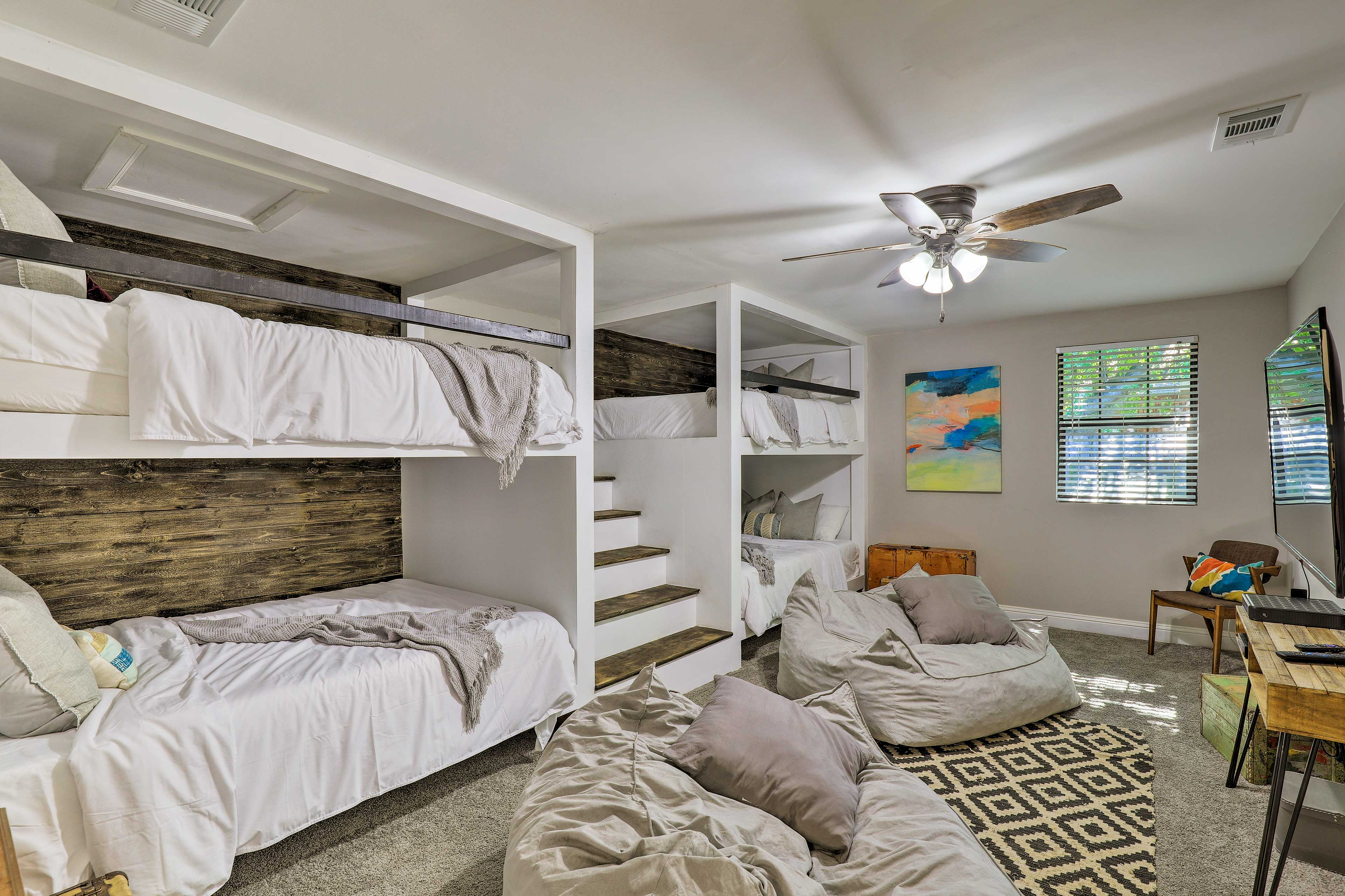 In the game room, you'll find 4 queen beds.