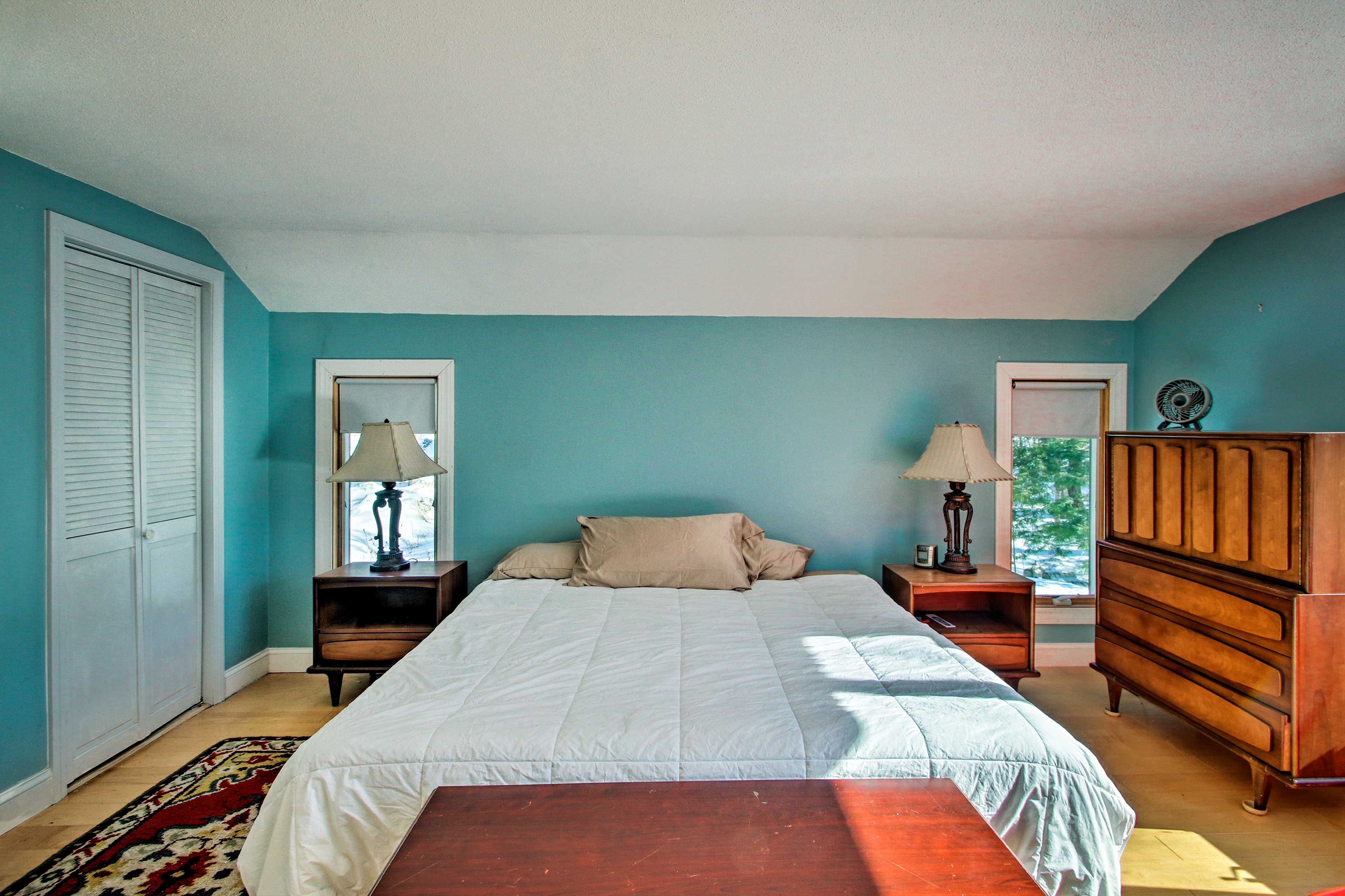 Two guests can sleep on the king-sized bed.