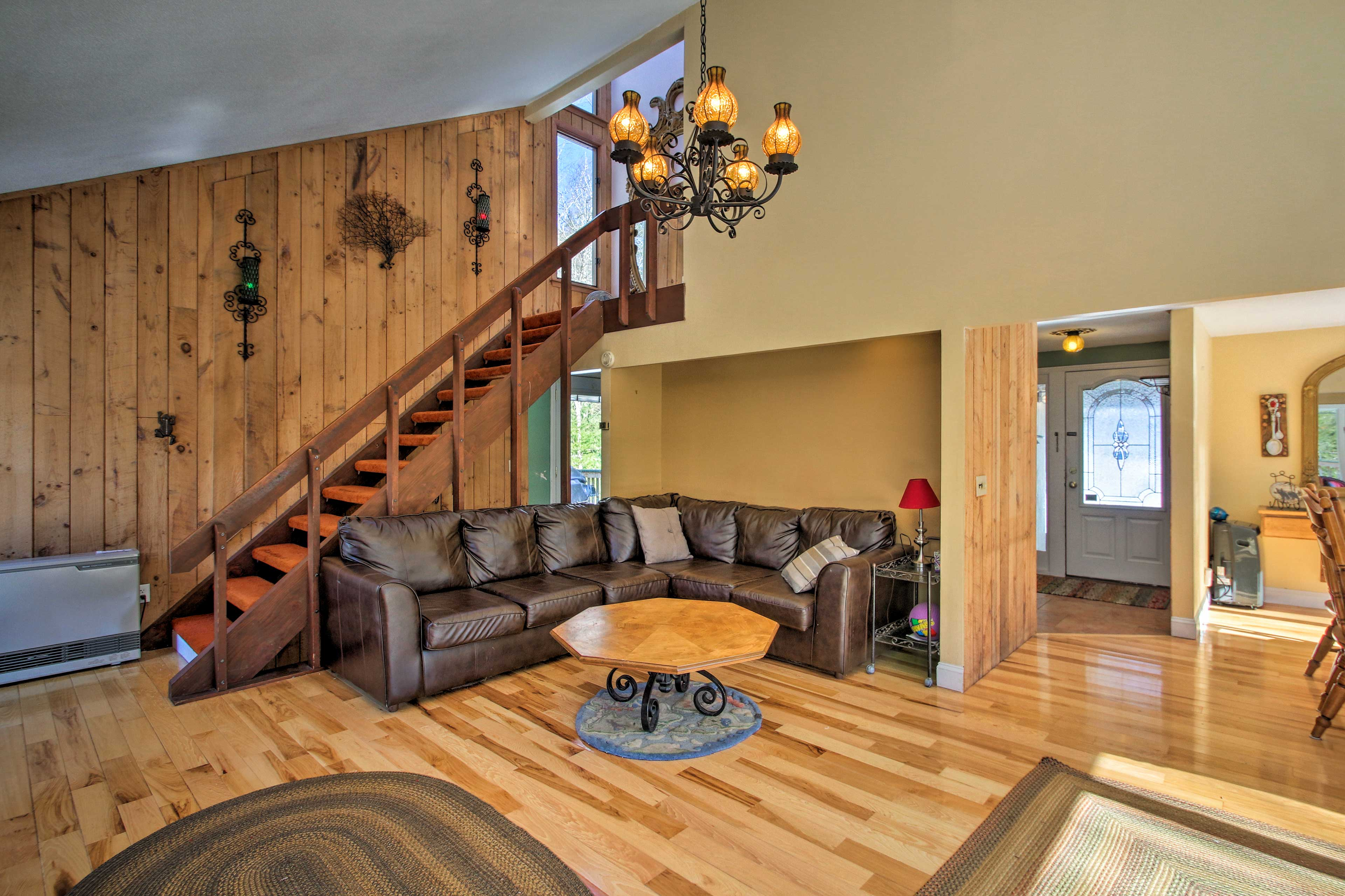 Kick back on the leather sectional couch in the living room.