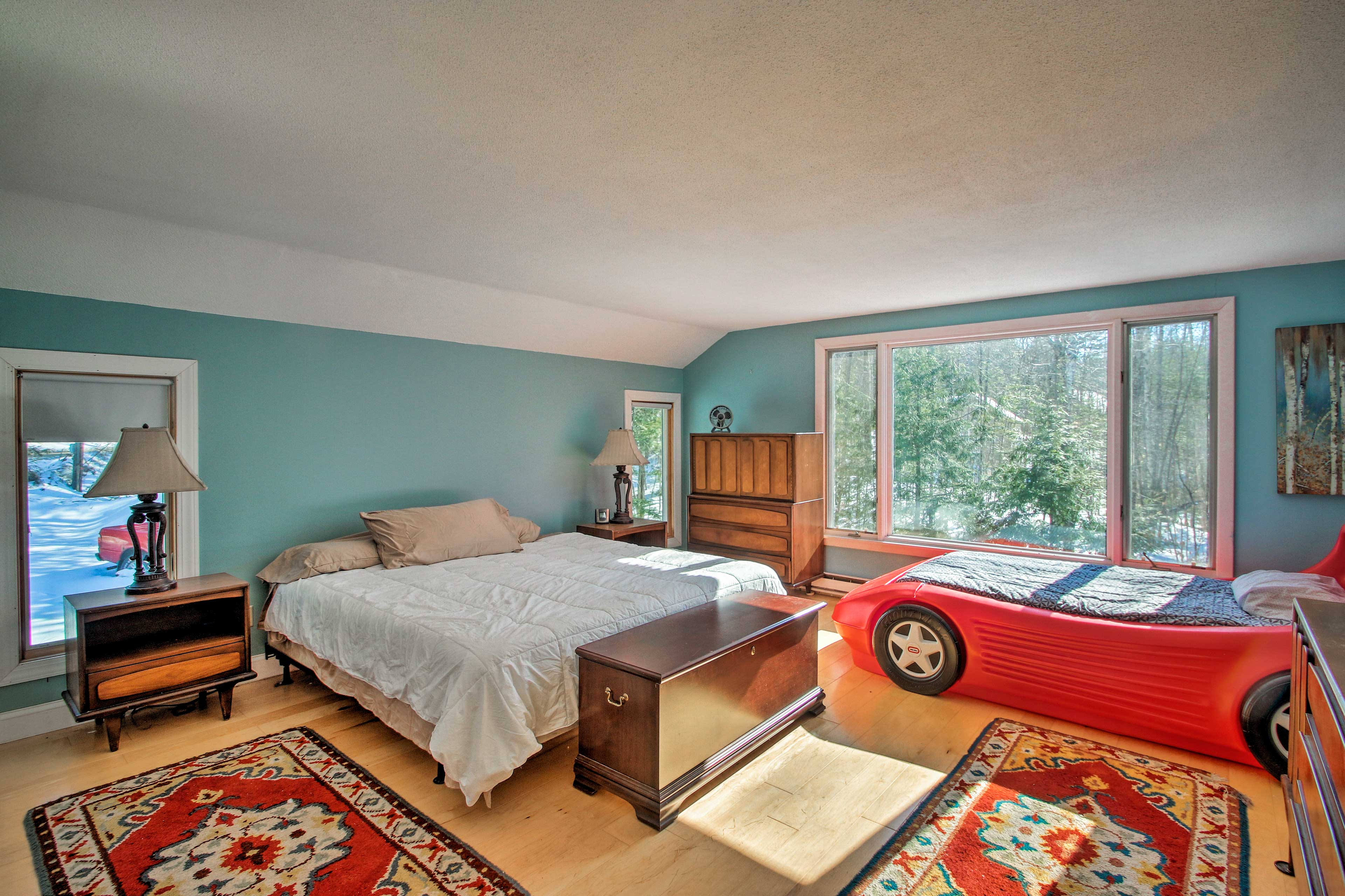 This room features a king bed and twin bed.