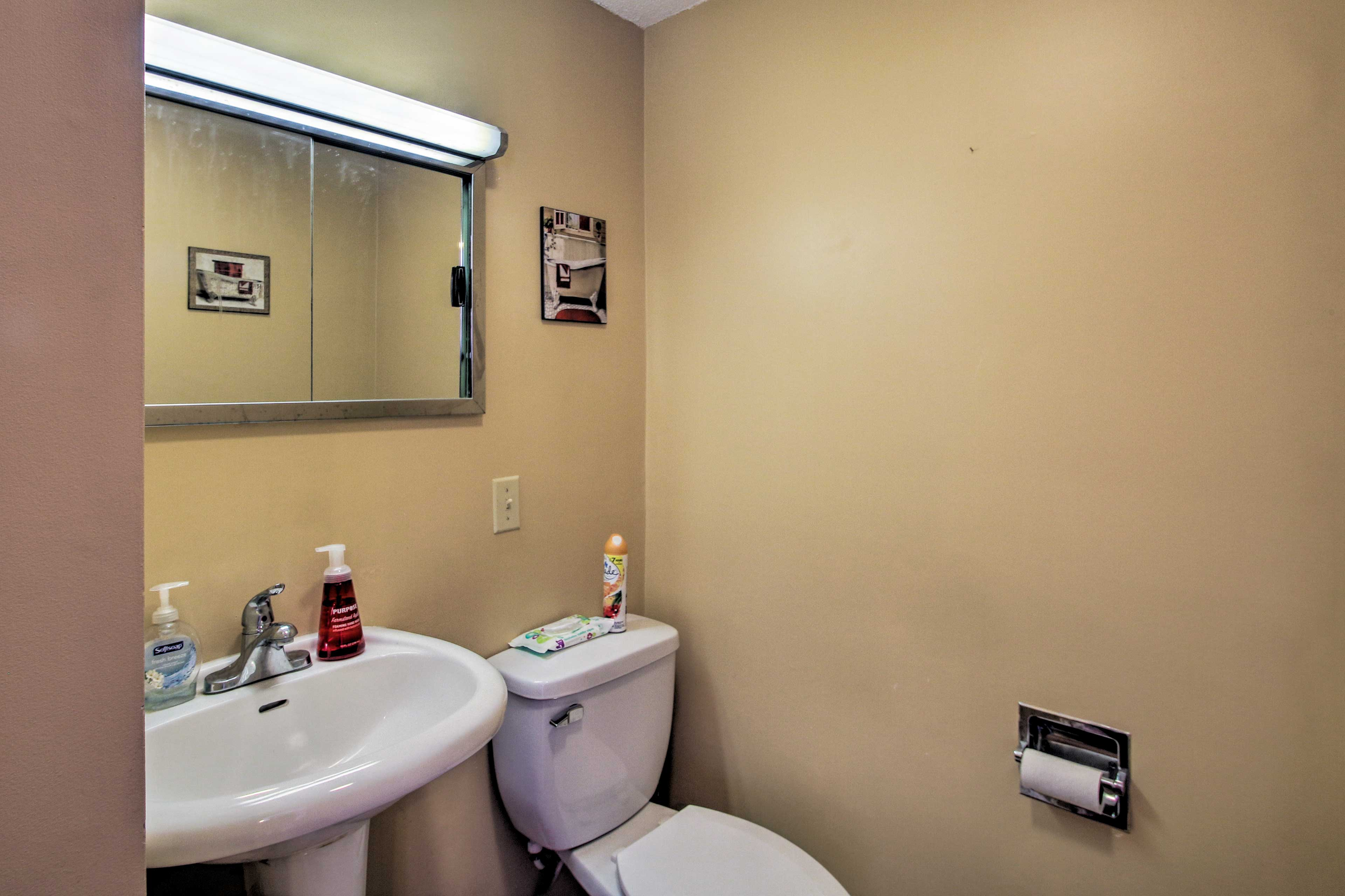 There are 2 full bathrooms and a half bath in this home.