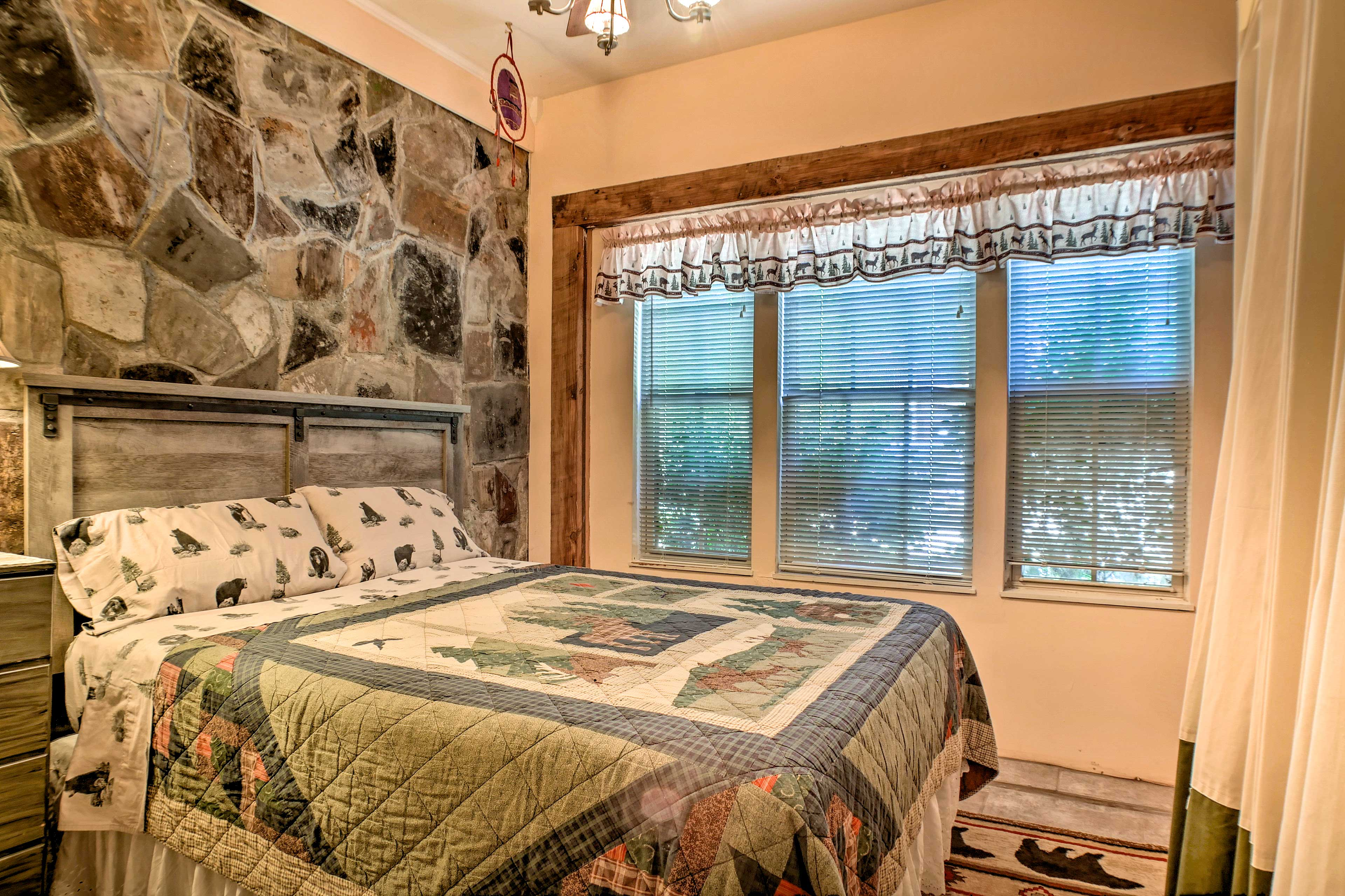 Just off of the dining room, you'll find a cozy bedroom with a queen bed.