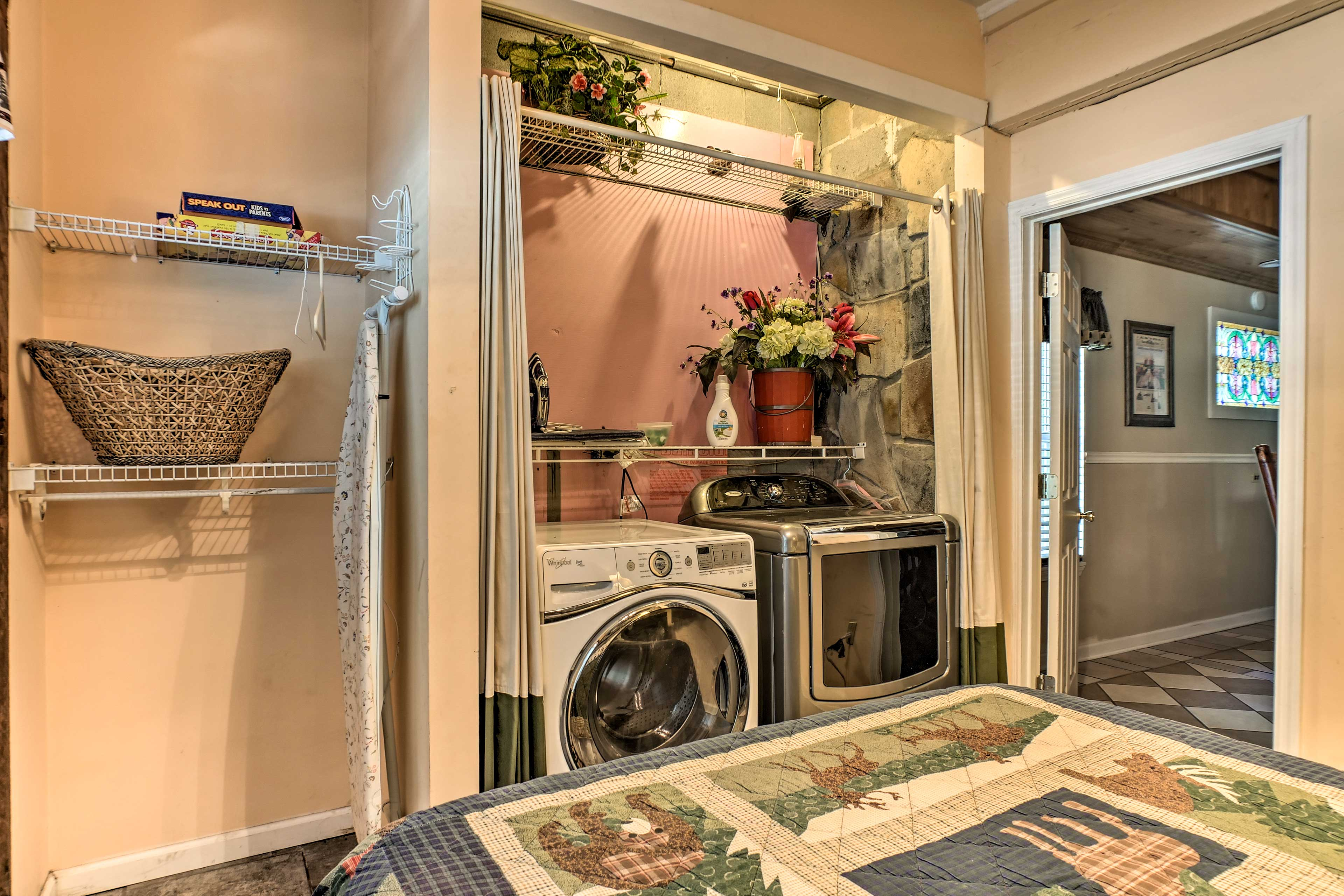 This bedroom also hosts the laundry machines.