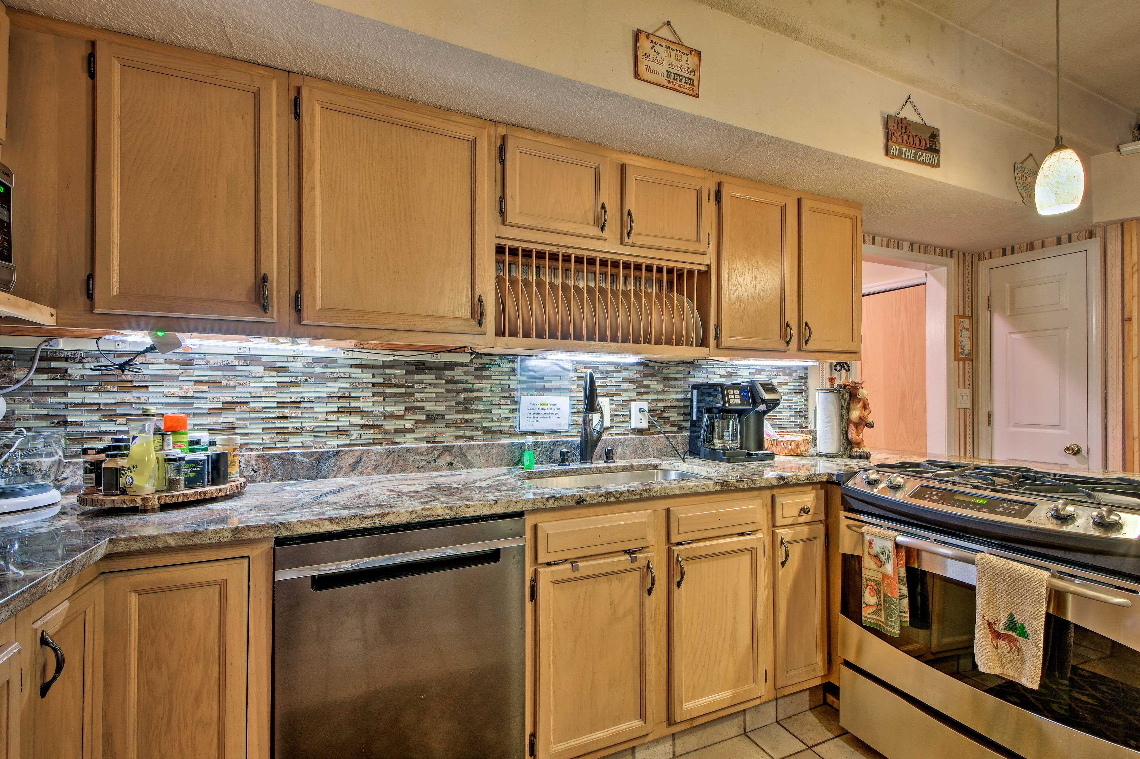 Granite lines the countertop perfectly complementing the modern appliances.