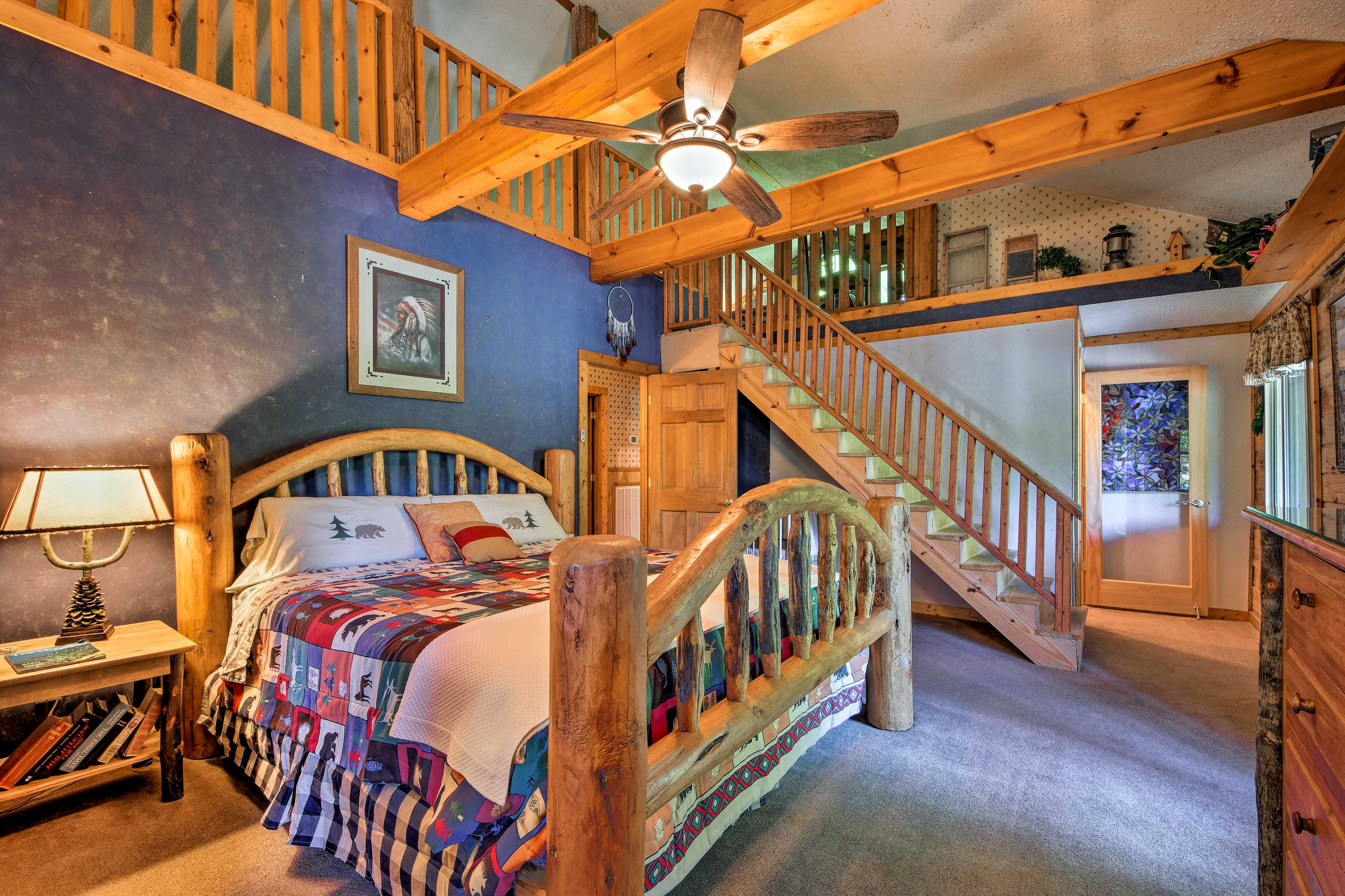 Exposed wood beams & a king wooden bed frame make this room feel rustic.